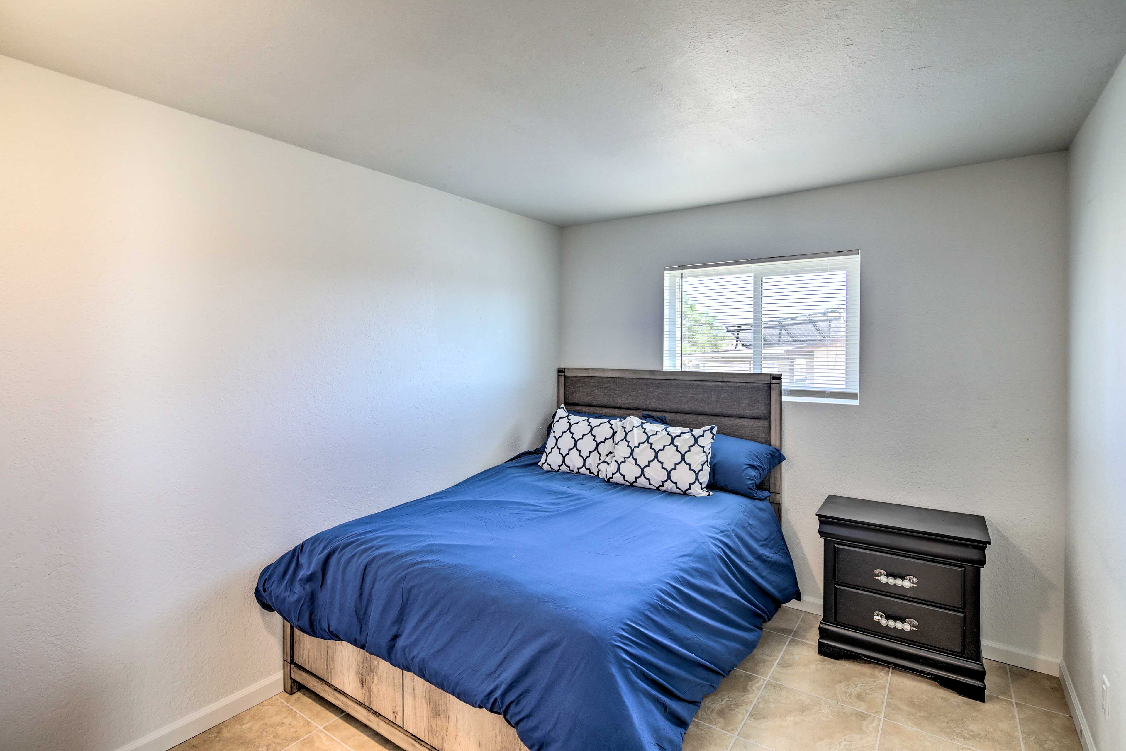 The second bedroom is outfitted with a queen bed as well.