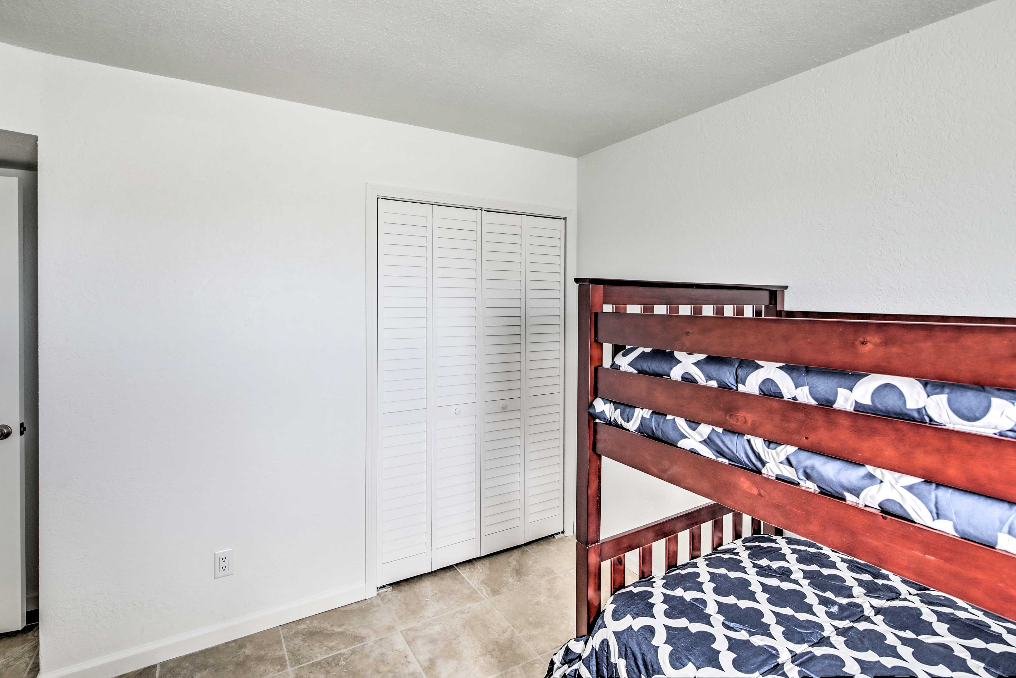 With 4 twin beds, up to 4 guests can stay in here!