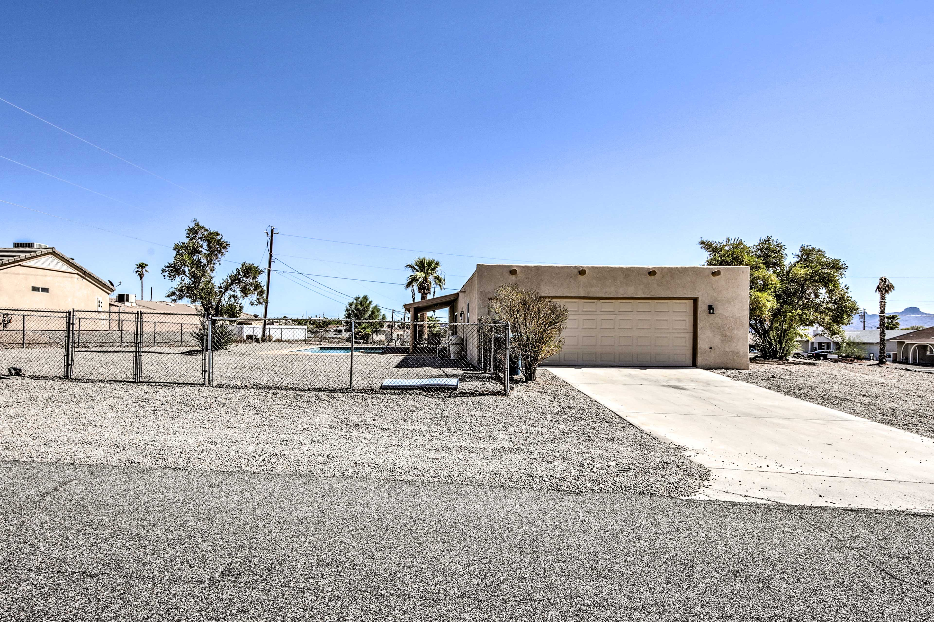 The fenced yard offers plenty of space!