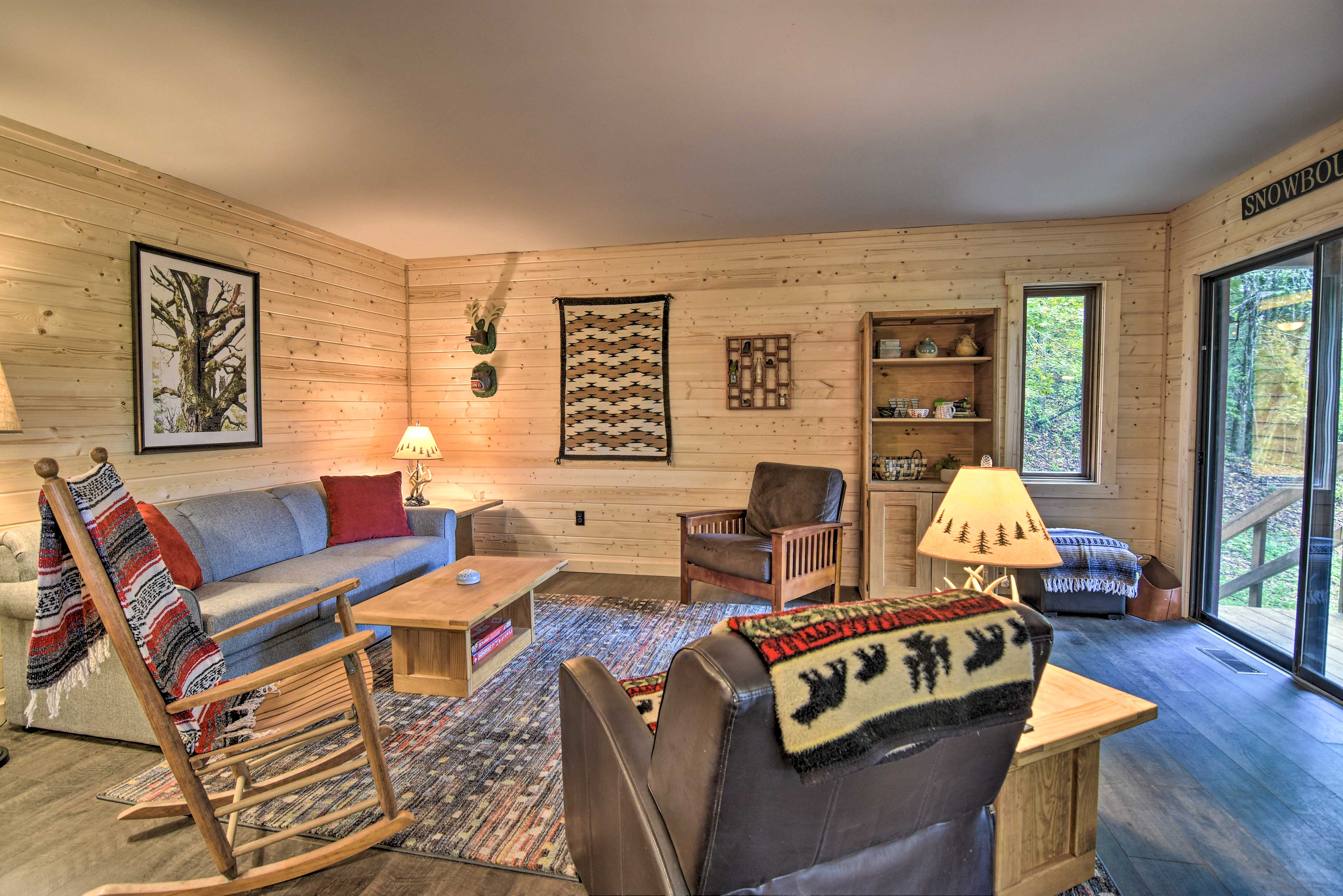 The 2-bed, 2-bath home features rustic cabin decor.
