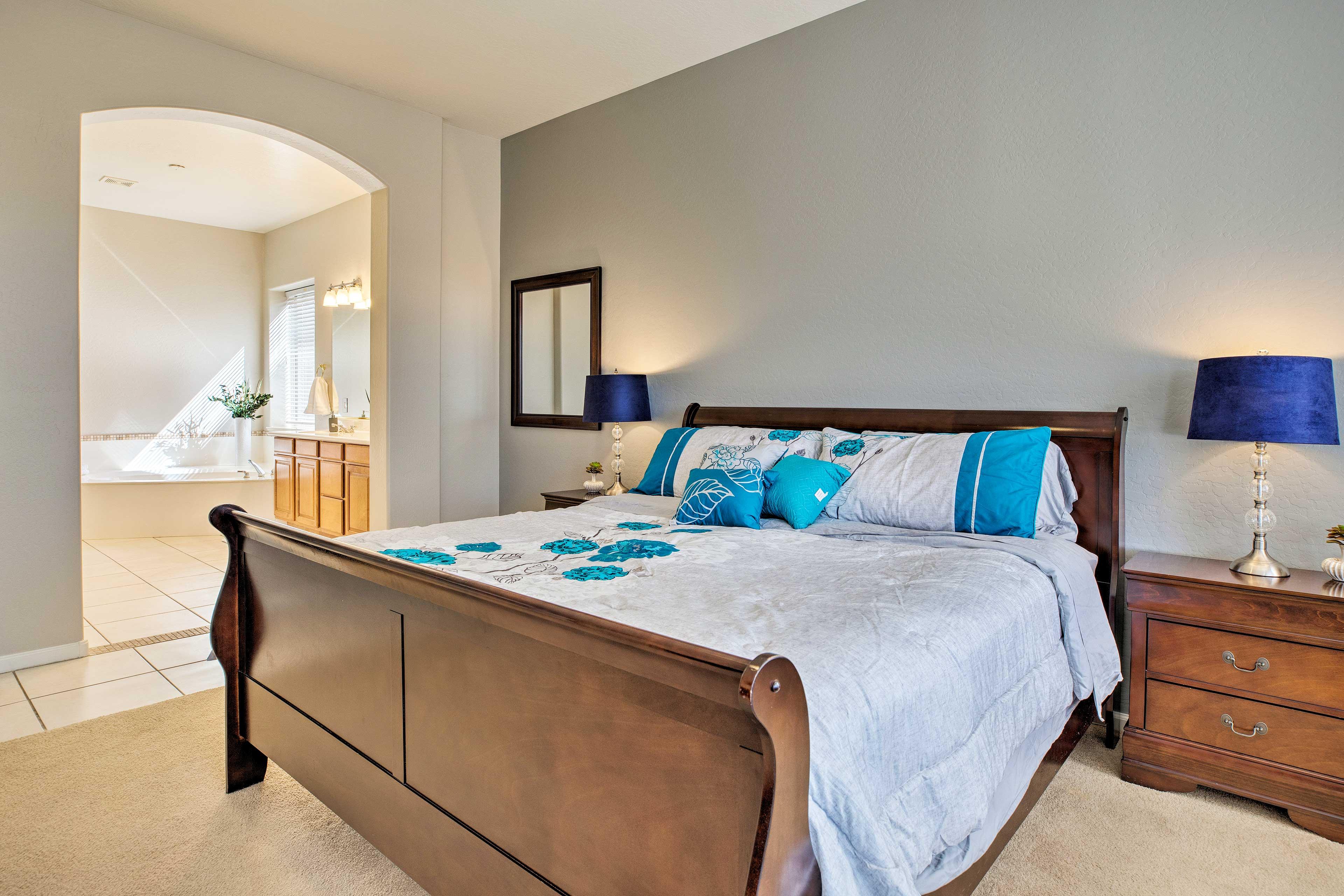 The master bedroom is complete with an en-suite bathroom.