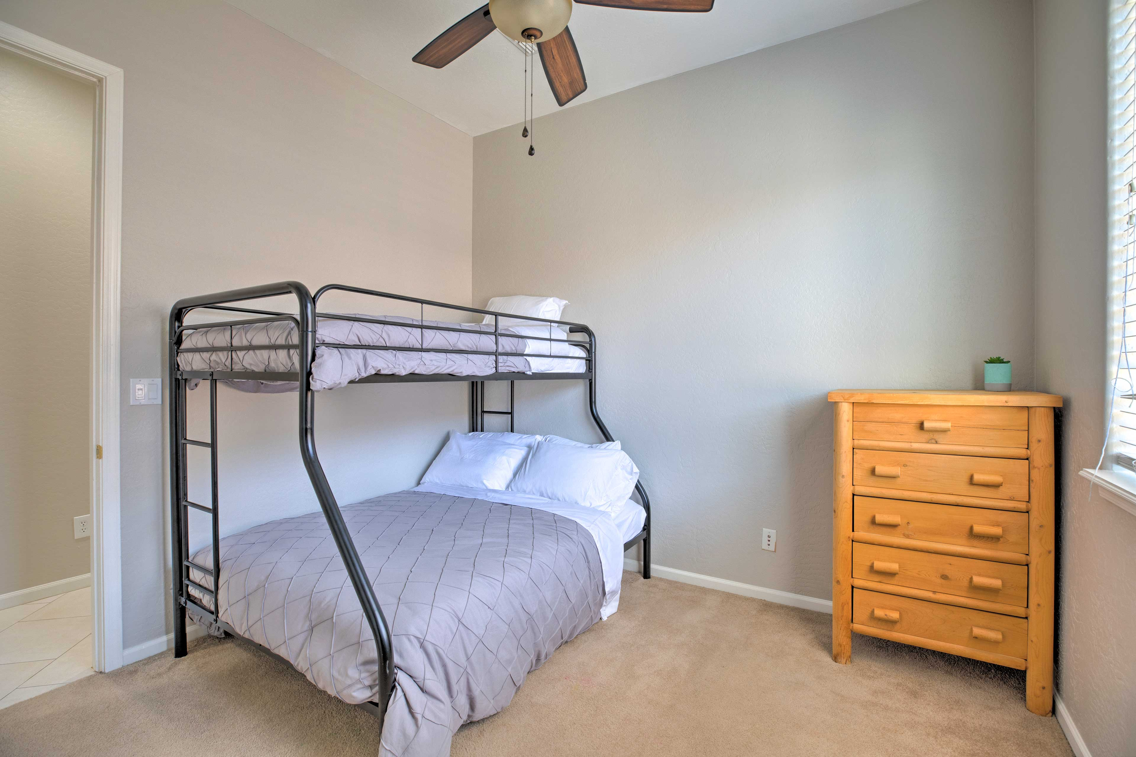The fourth bedroom features a twin-over-full bunk bed.