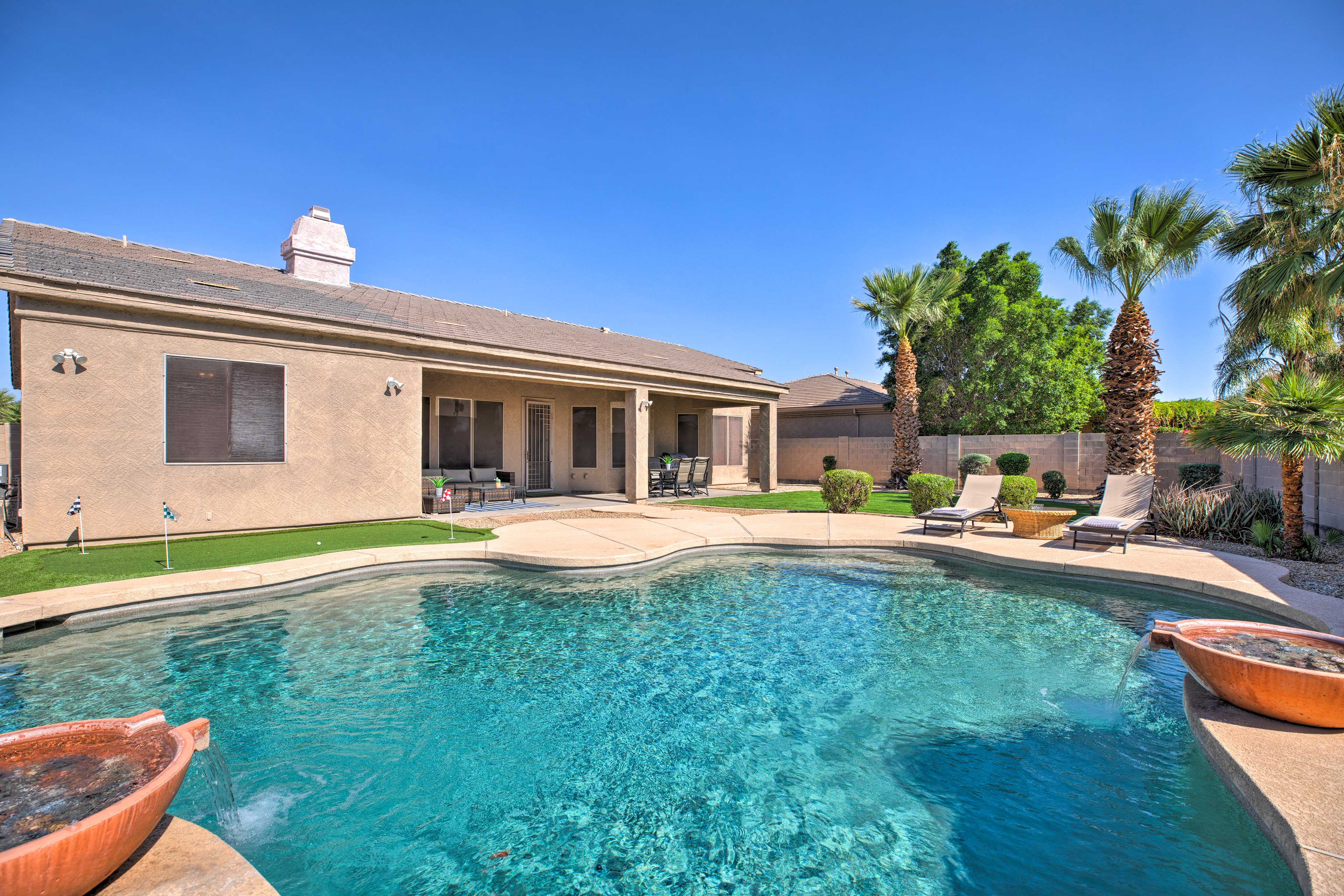 Up to 10 guests can enjoy this serene oasis in Goodyear!