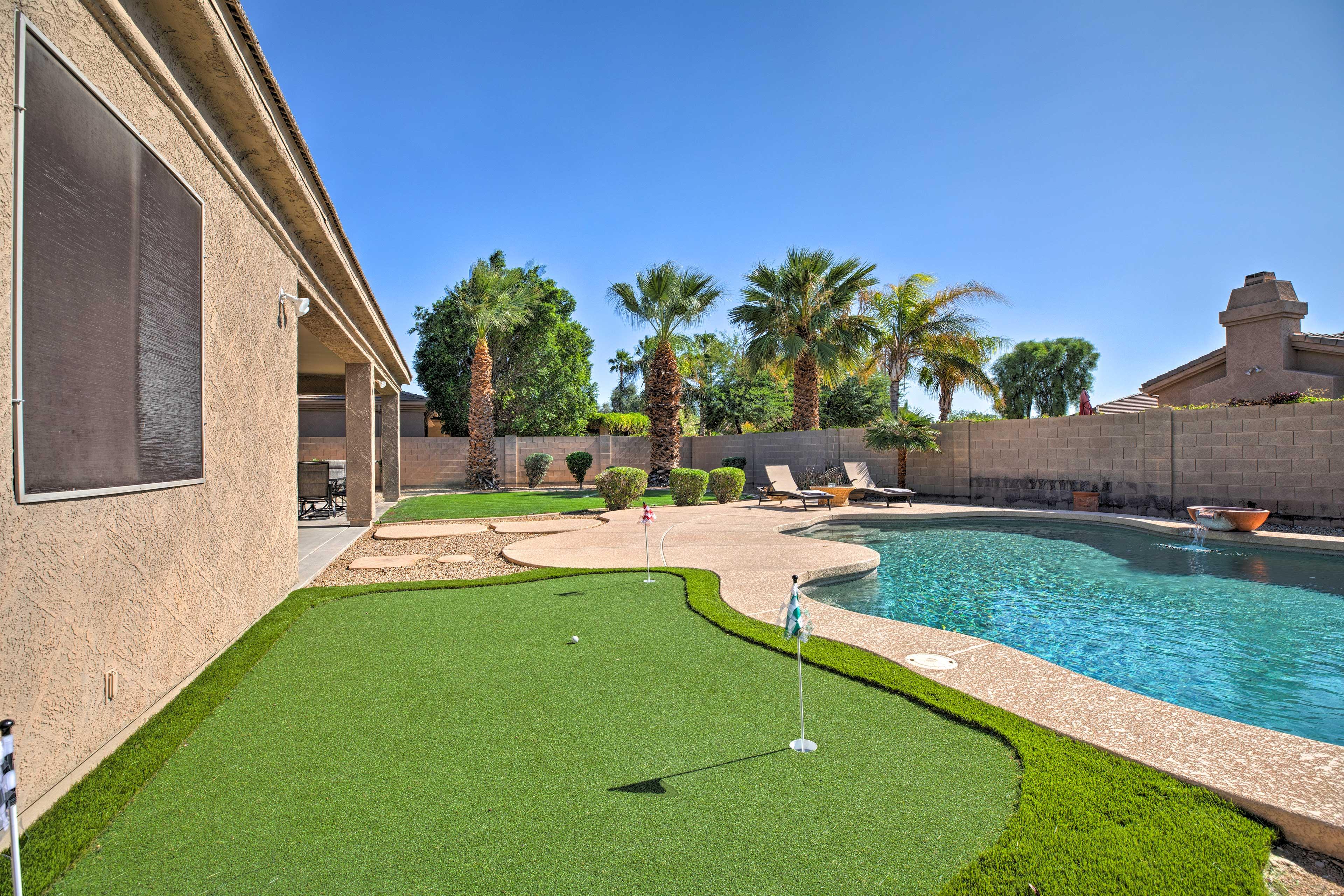 The spacious backyard offers plenty of sun & shade!