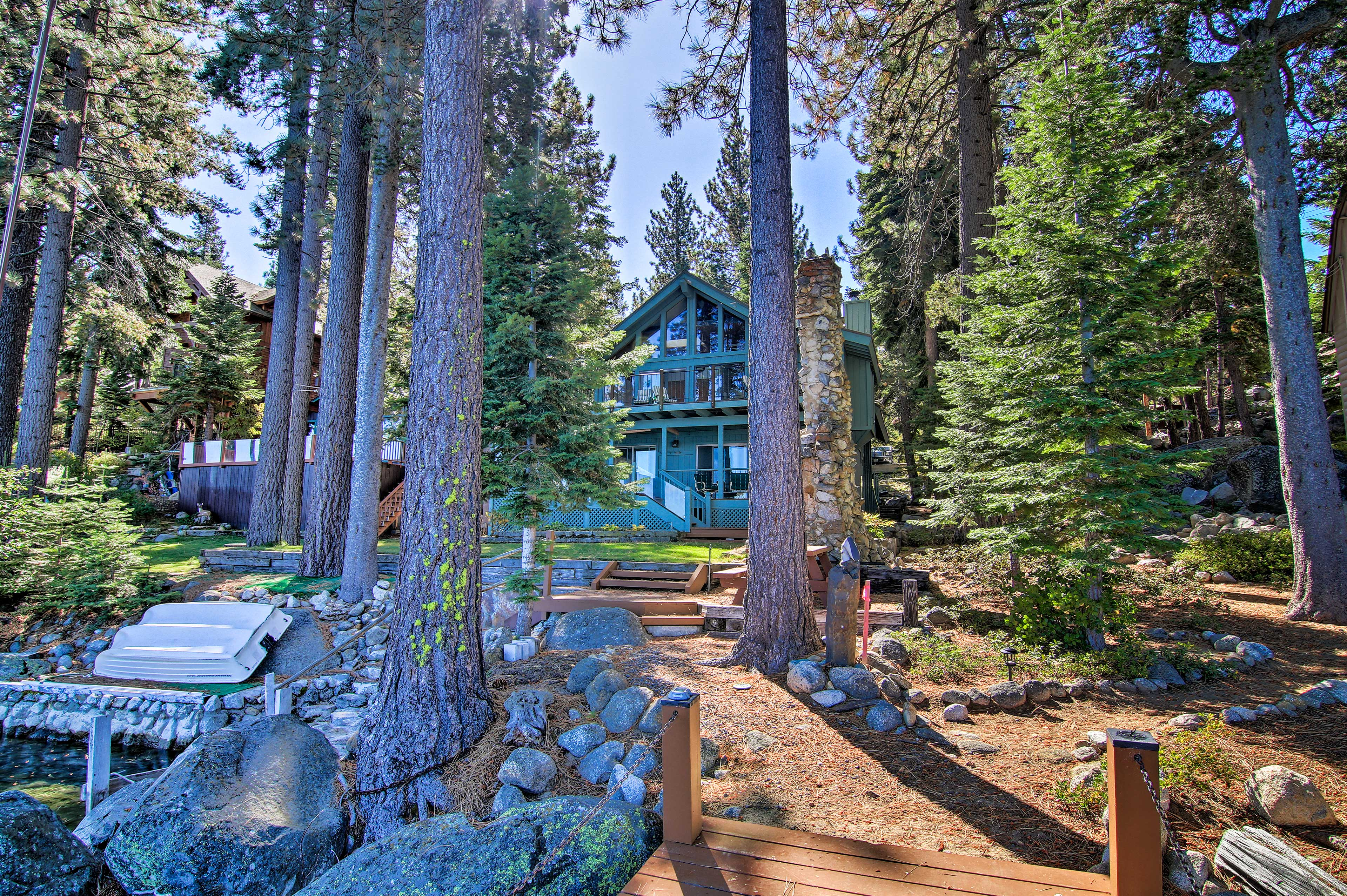 Walk through the wooded yard of the property to get to the private dock.