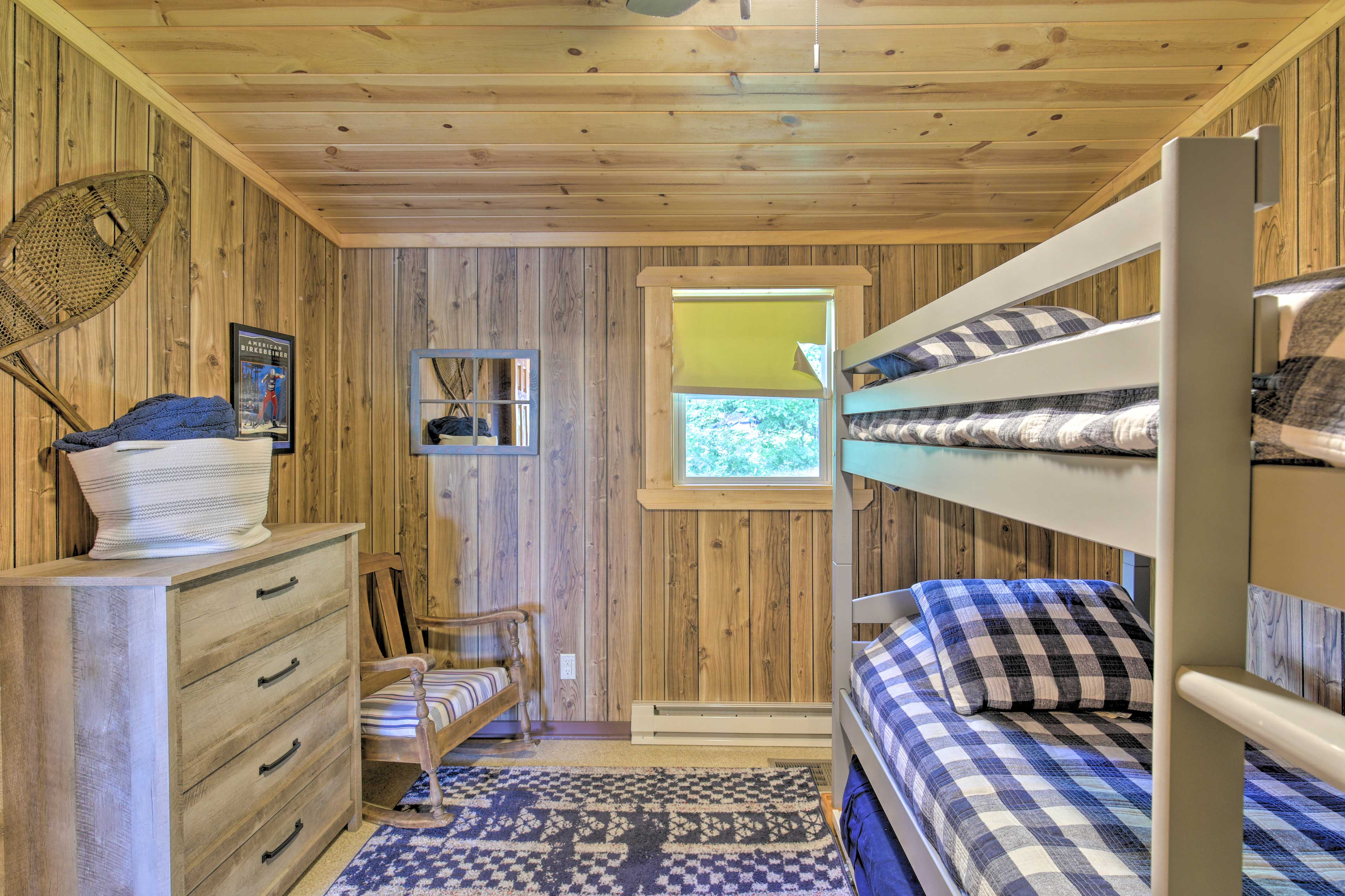 The second bedroom offers a twin bunk bed and a twin trundle.