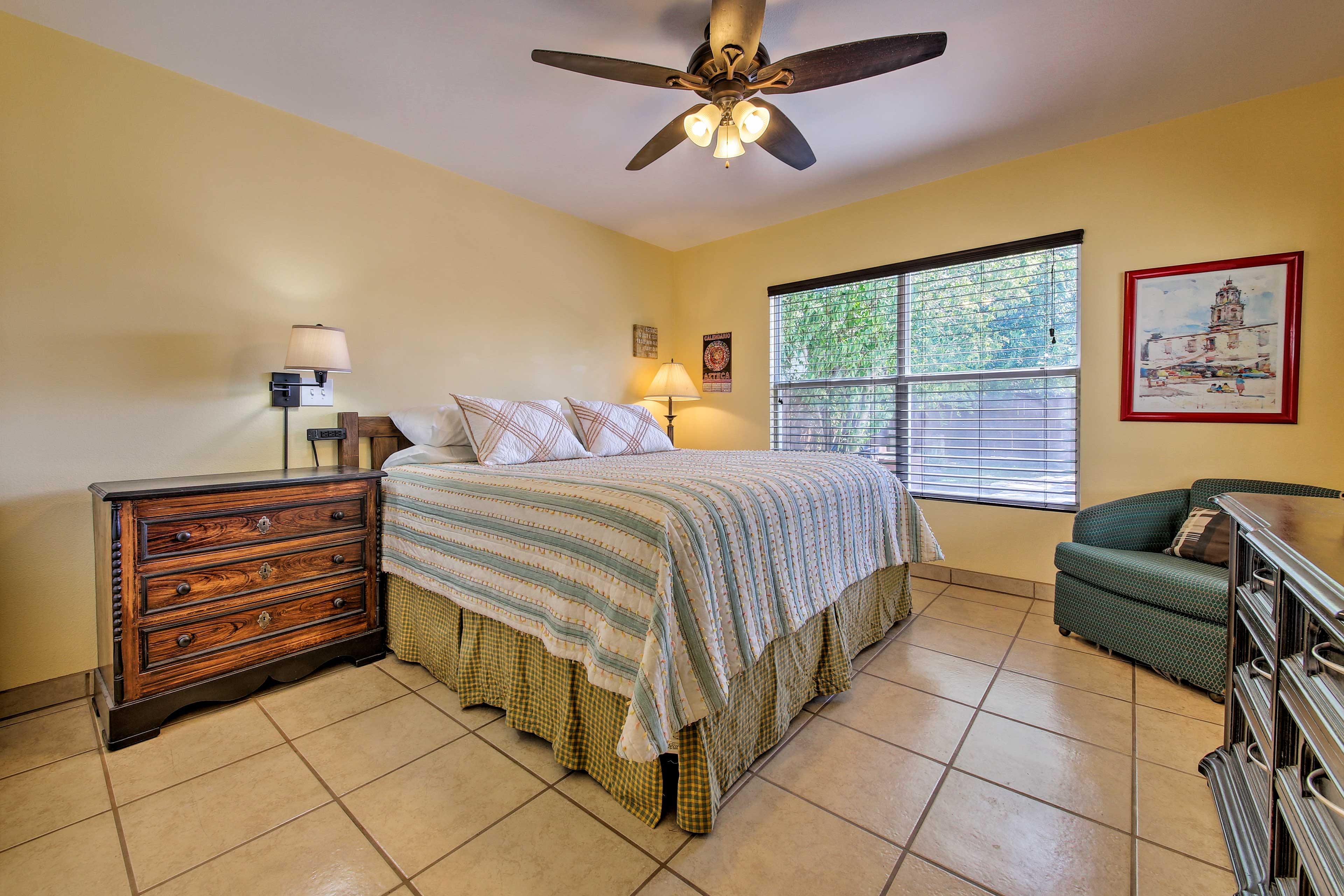 Fall into this king-sized bed in the master bedroom.