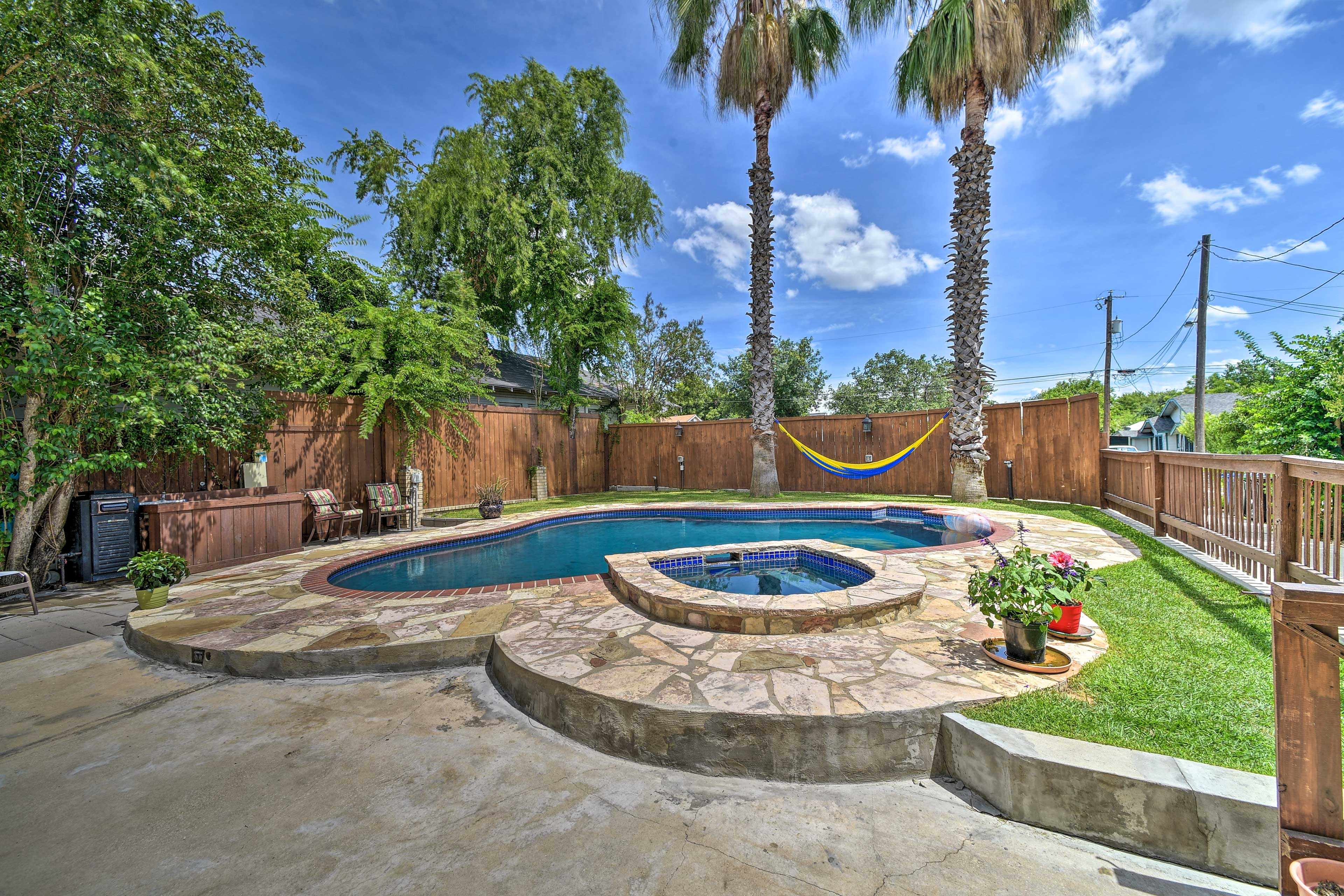 Soak up the sun out back in this outdoor oasis.