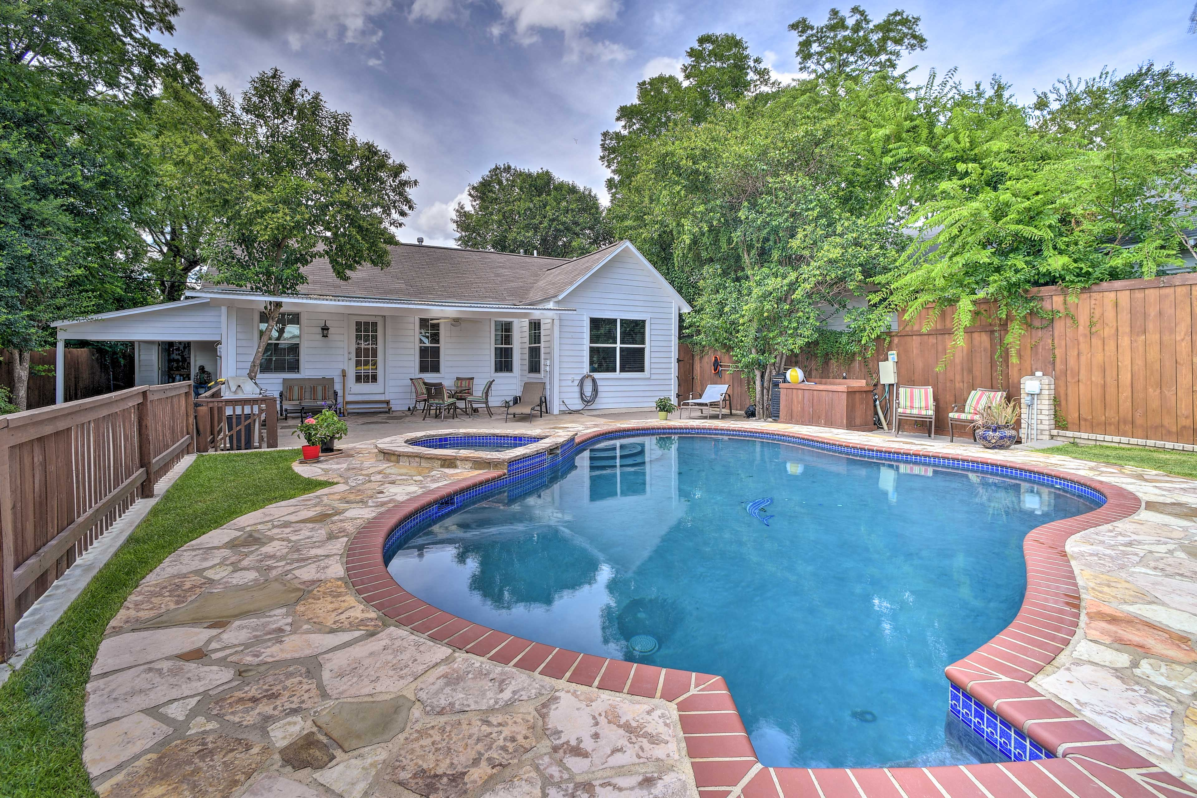 Take a dip in the private pool at this 3-bedroom, 3-bath home in San Antonio!