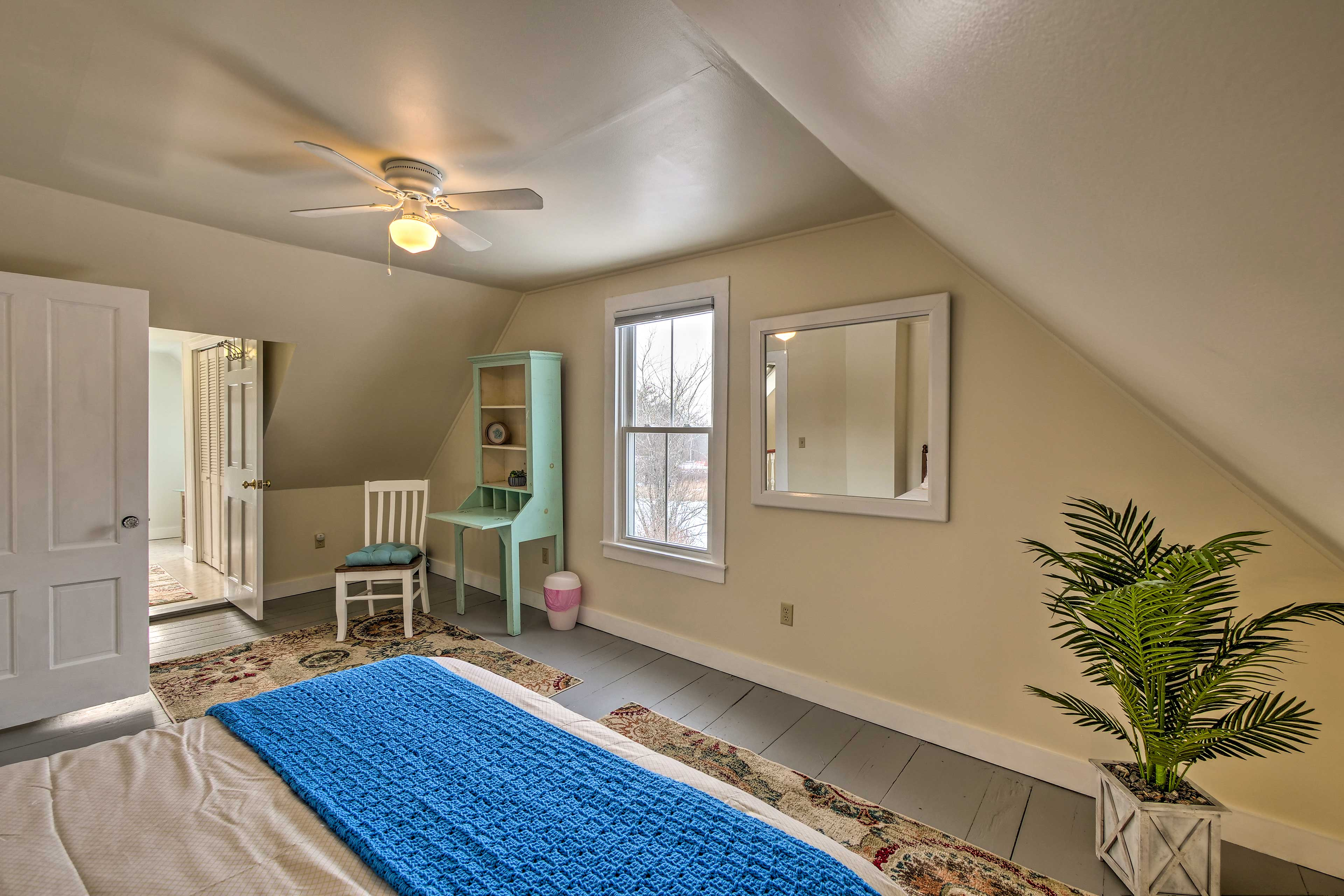The master bedroom features a queen bed for 2 guests to sleep in.