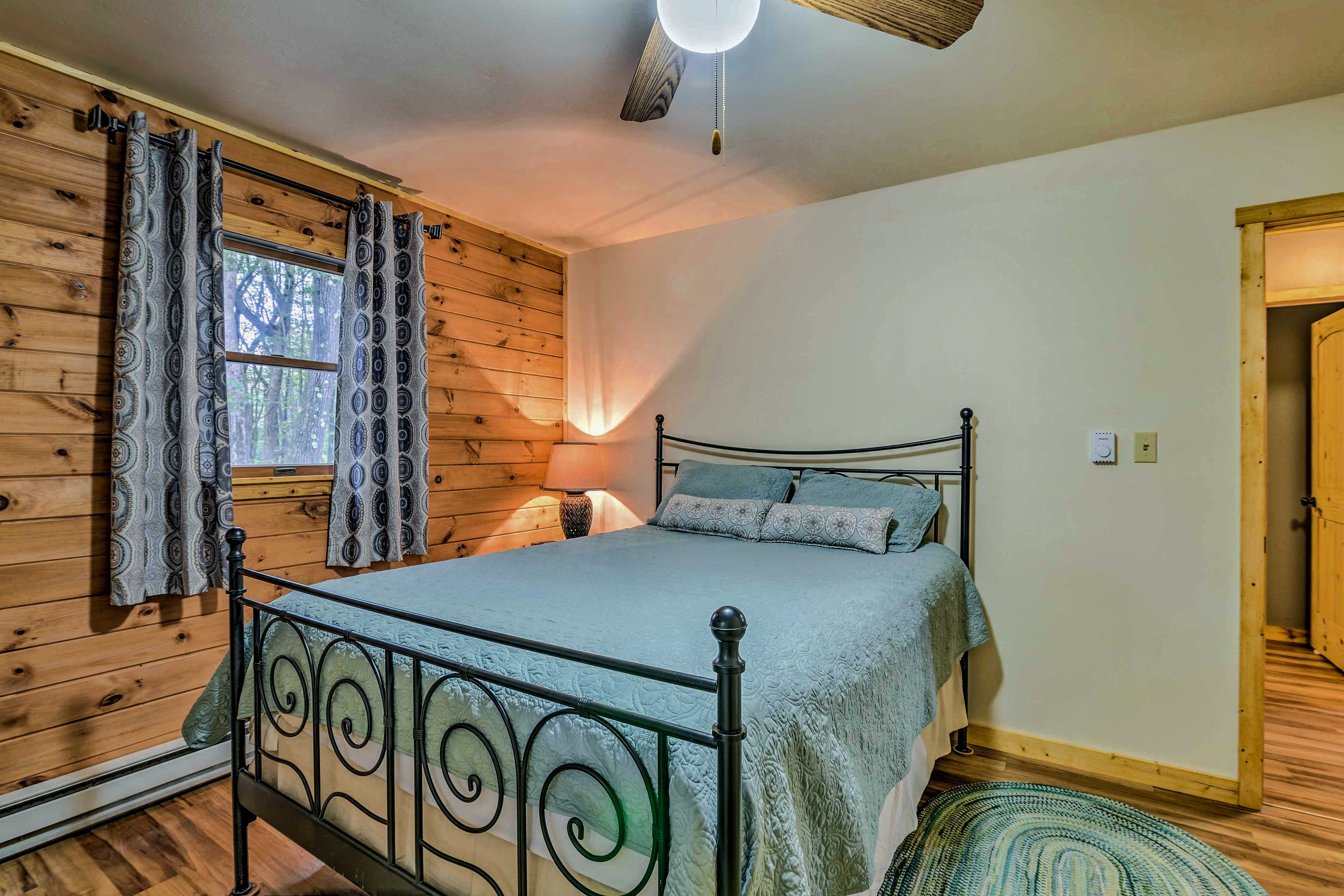 The second room is outfitted with a queen-sized bed.