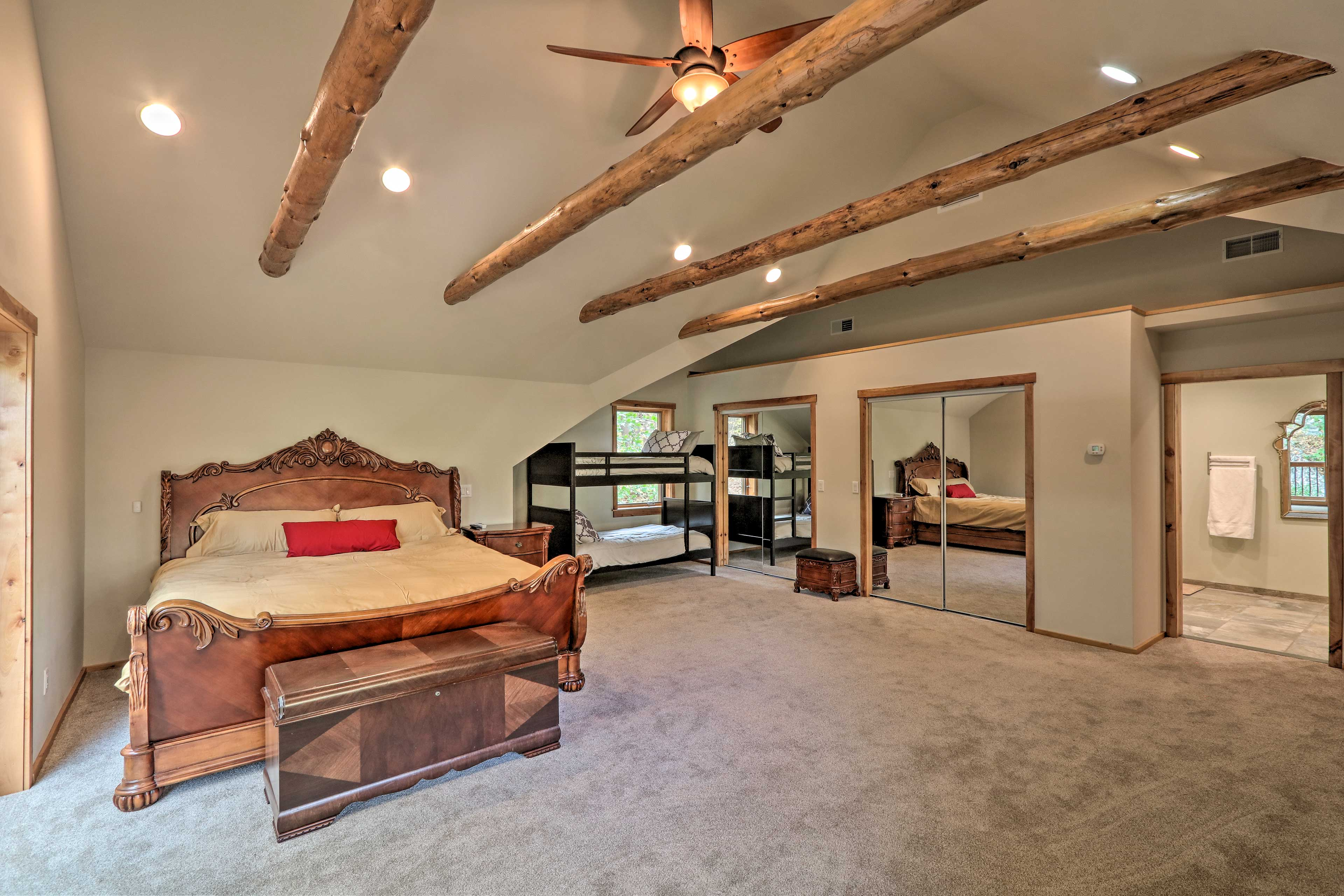 This spacious bedroom features a king bed, plus a twin bunk bed.