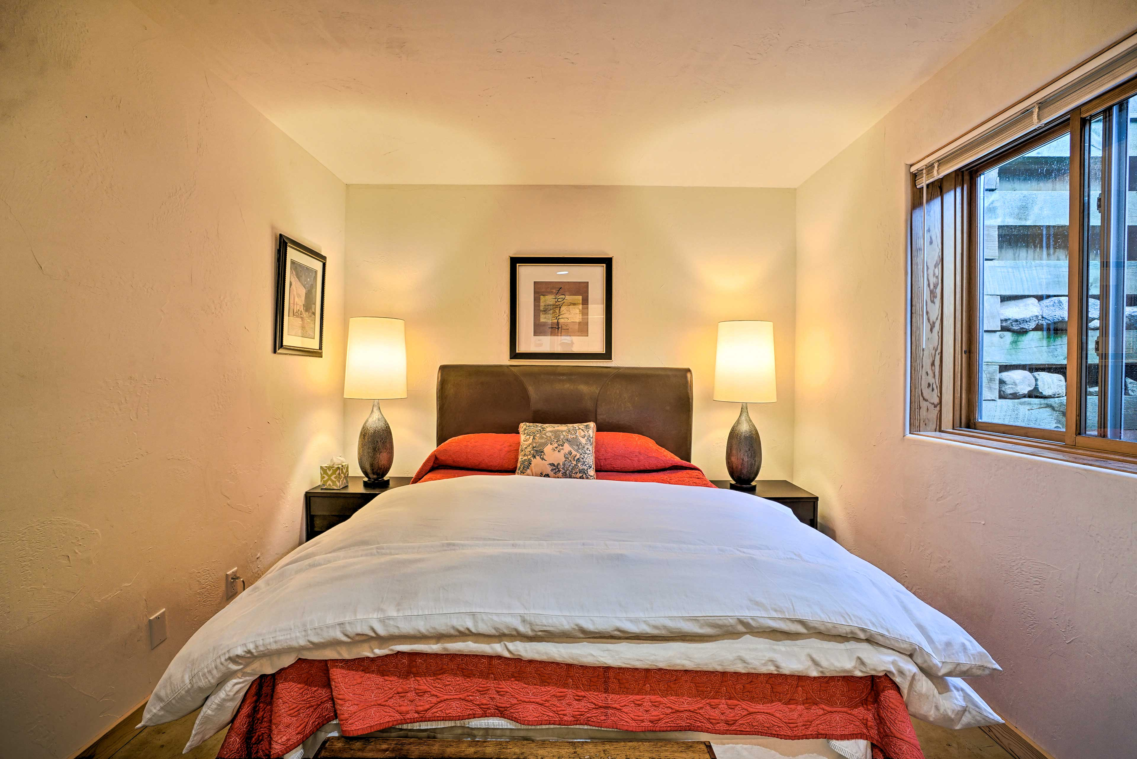 The master bedroom is awaiting your stay!