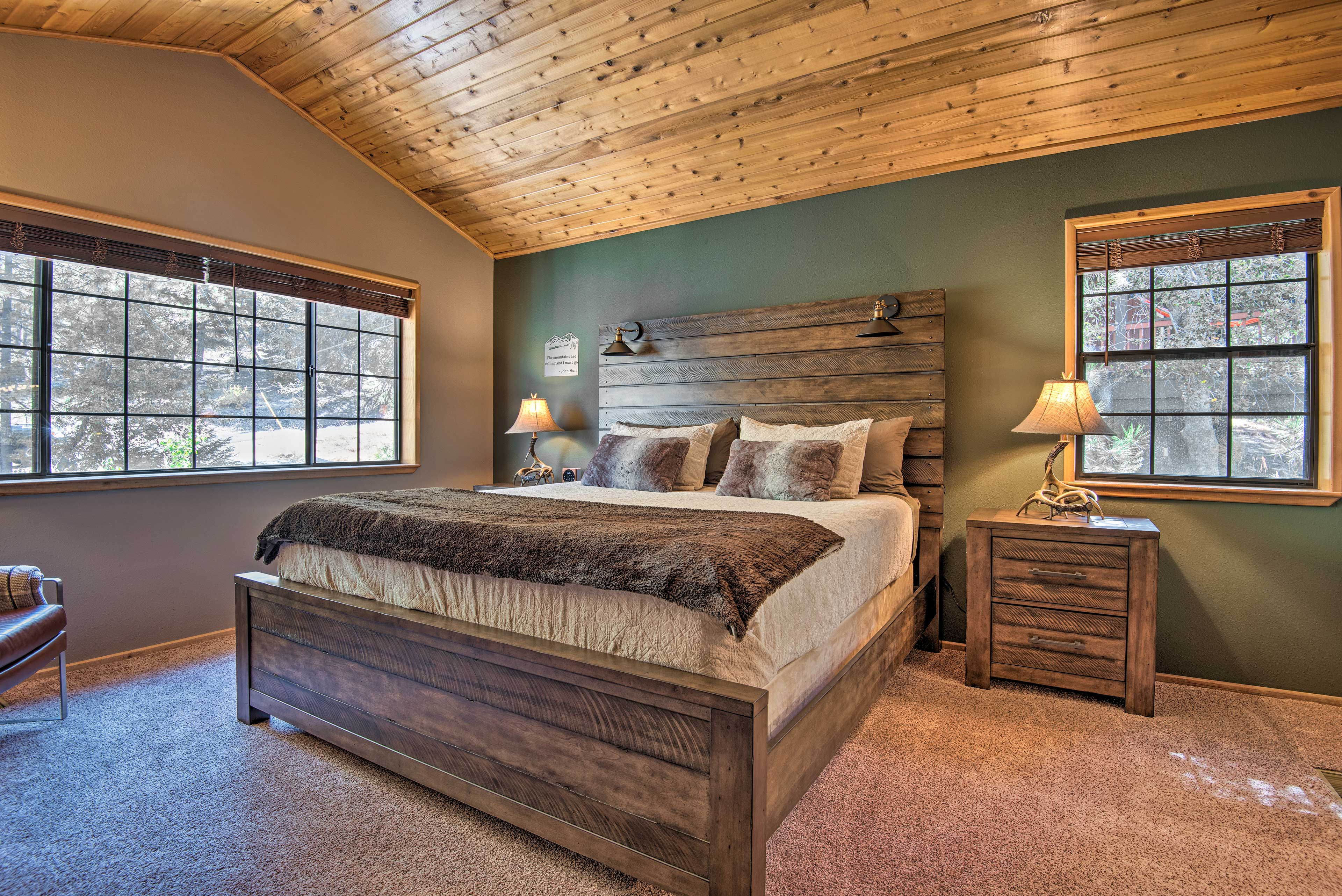 The master bedroom is complete with a king-sized bed.
