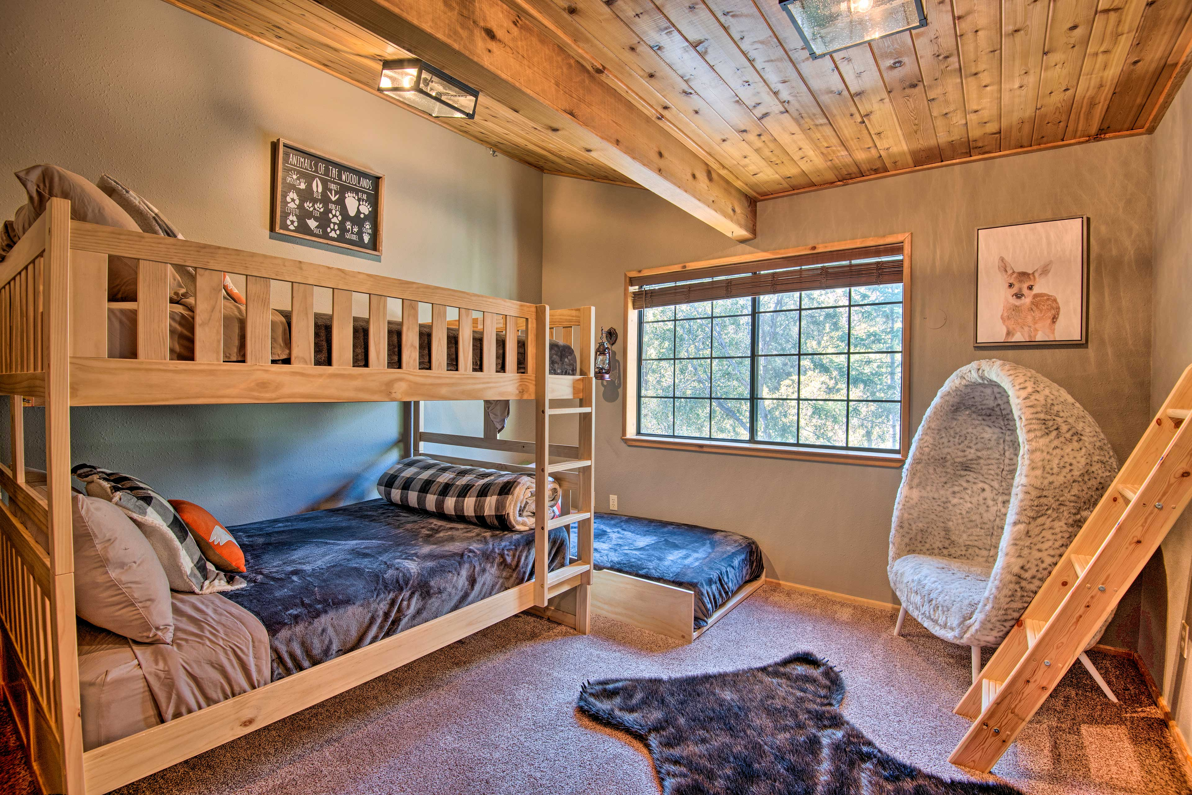 The second bedroom features 2 full bunk beds and a twin bed.
