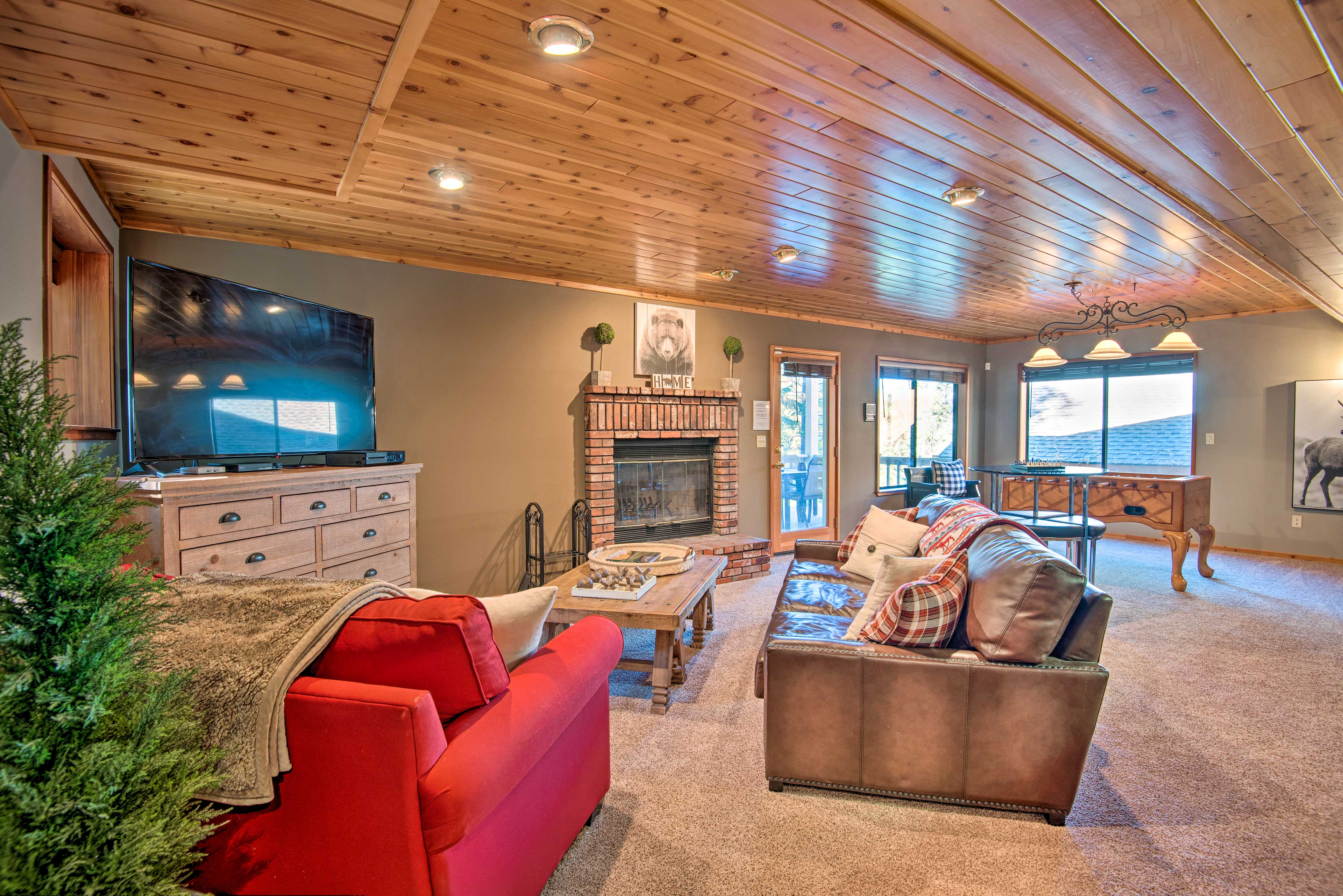 The second living area boasts a large flat-screen TV and seating.