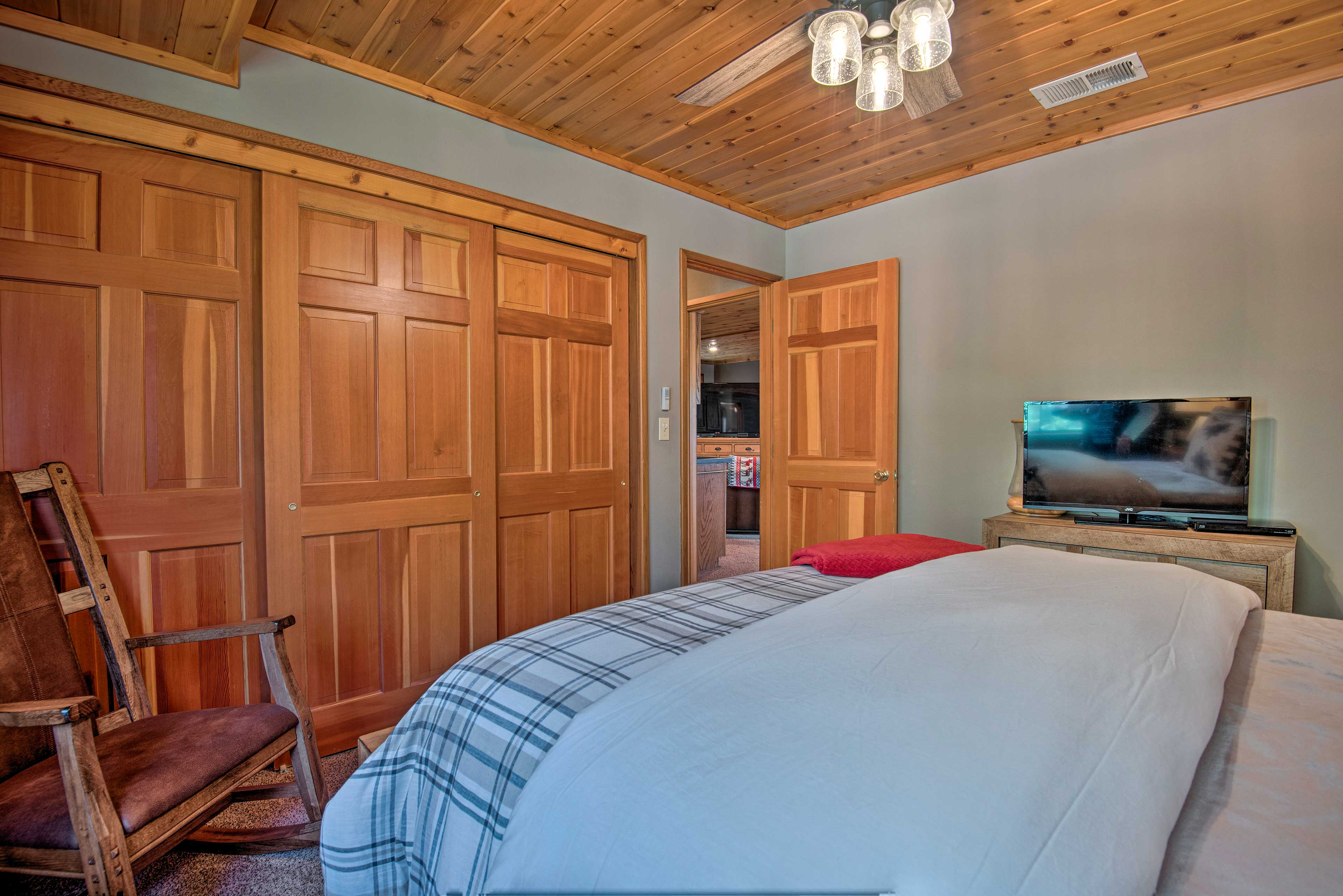 The master bedroom is complete with a flat-screen TV and spacious closet.
