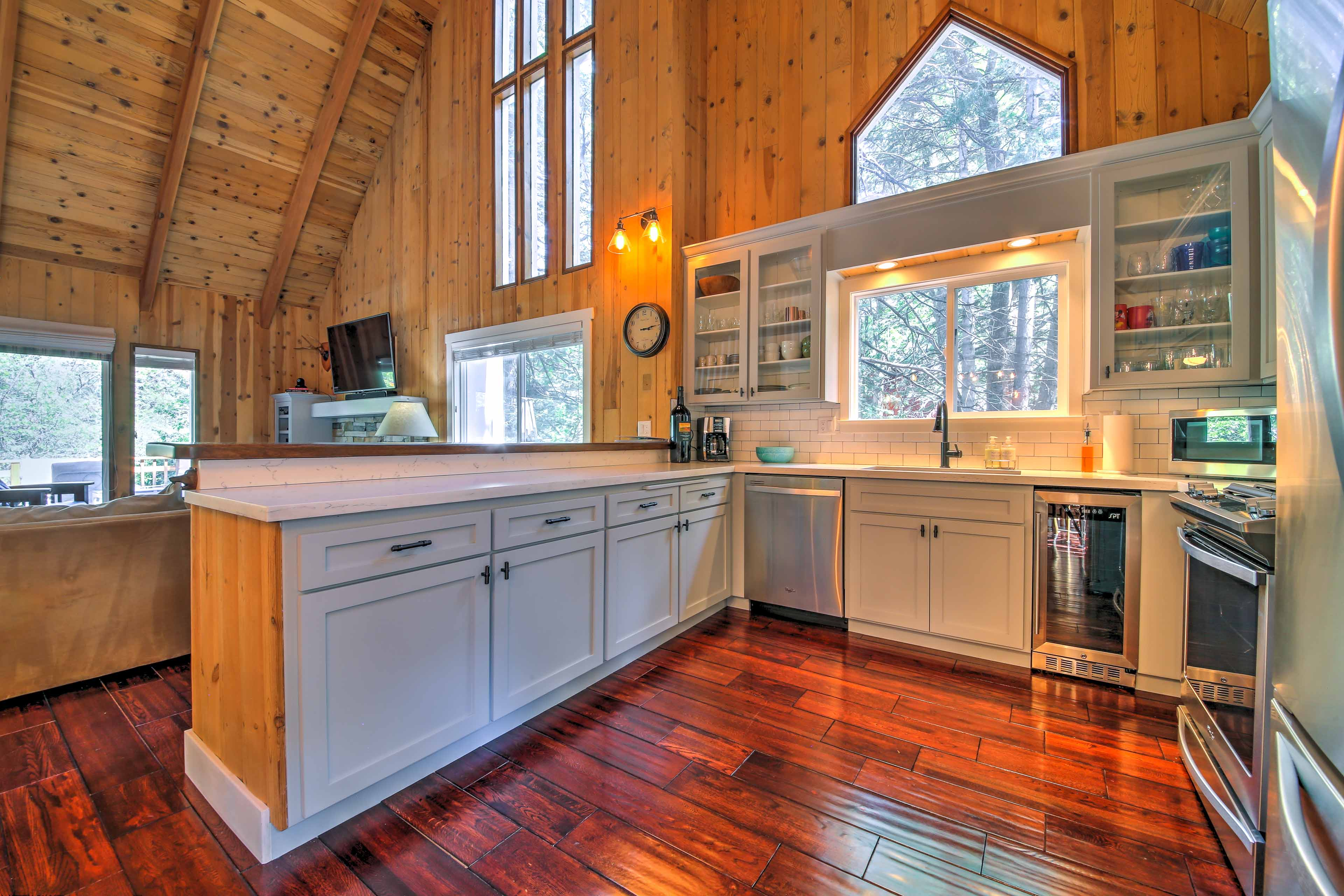 The updated kitchen offers stainless steel appliances and quartz countertops.