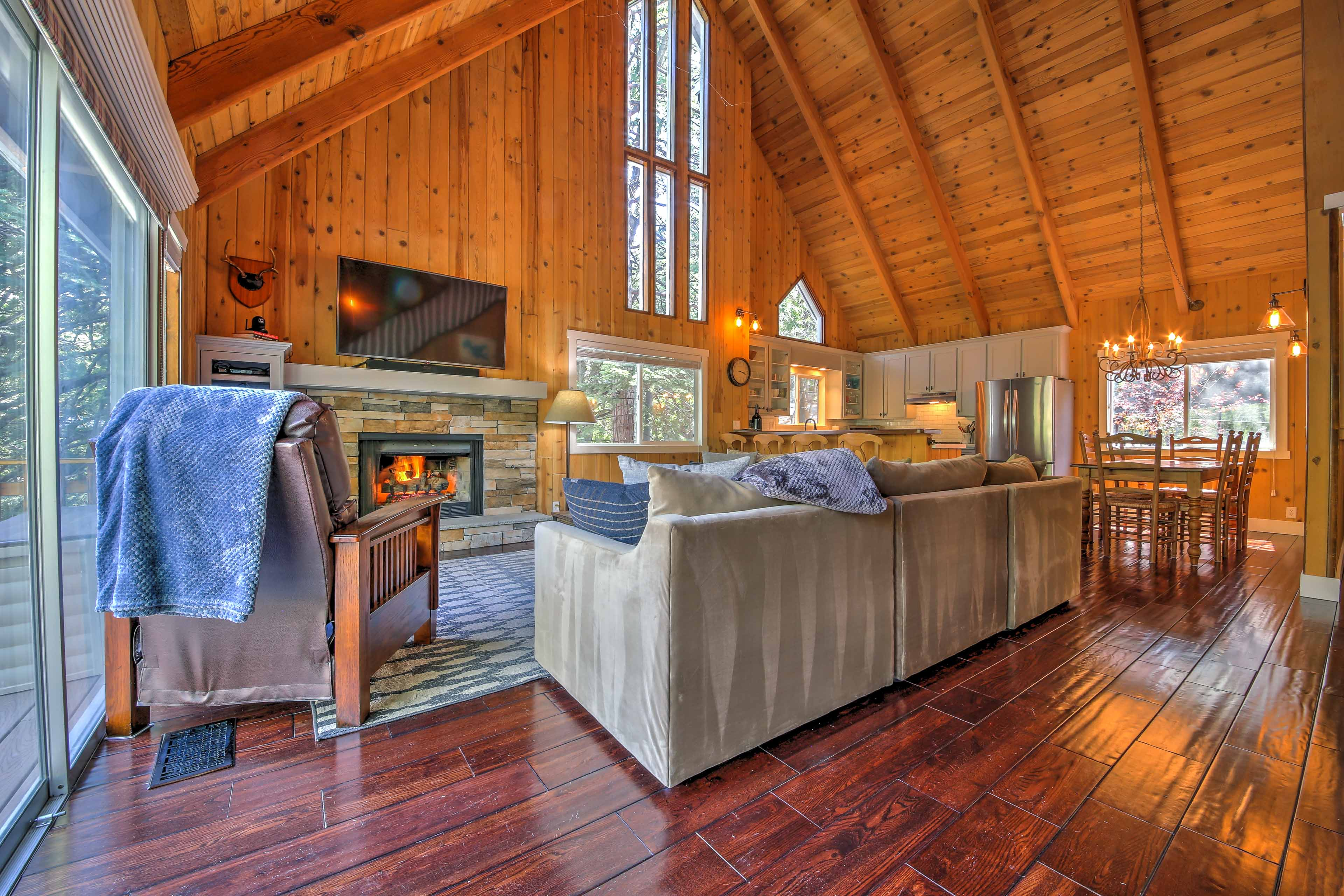 Warm up in front of the gas-powered fireplace and watch the flat-screen TV.