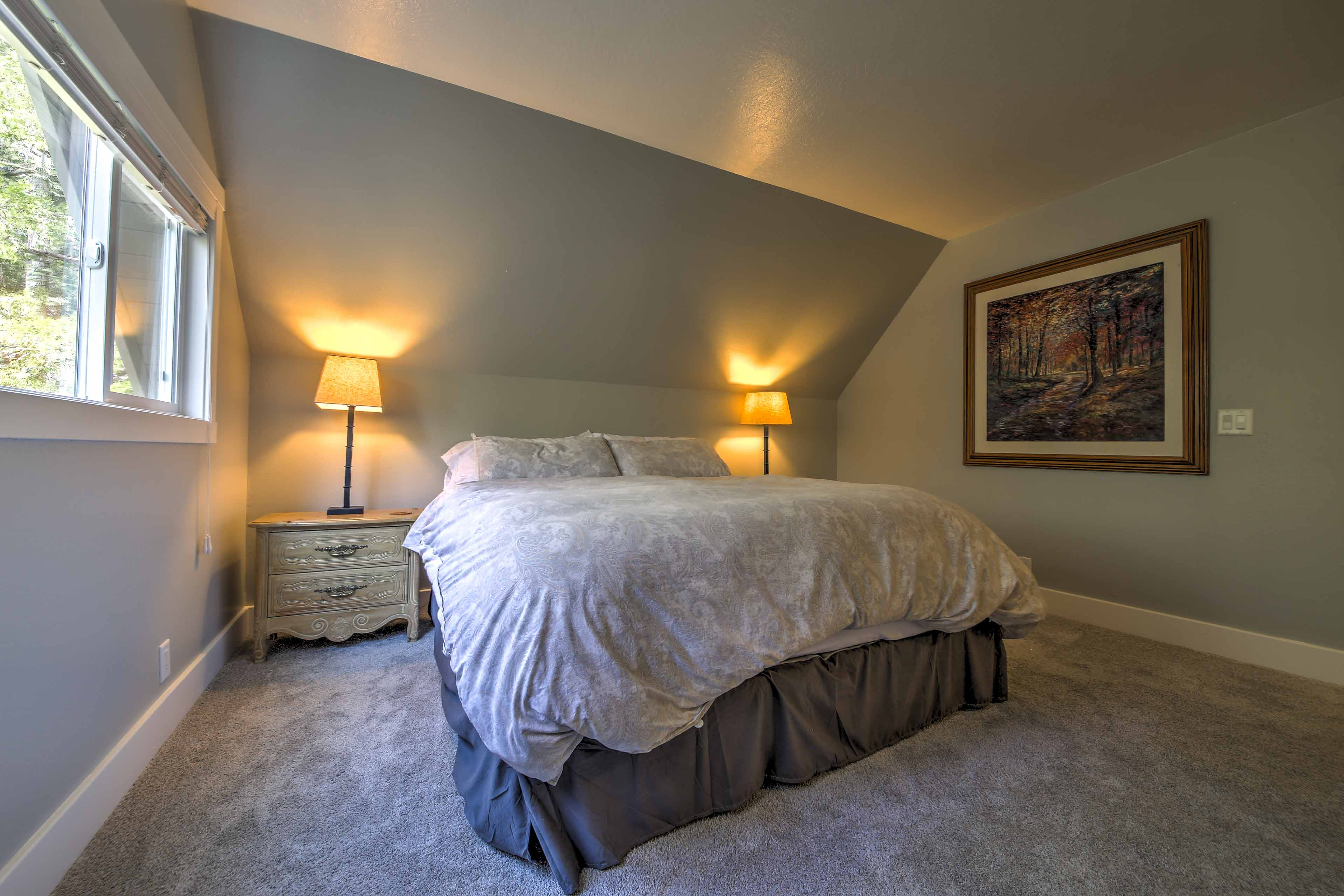 The master bedroom boasts a spacious king-sized bed.