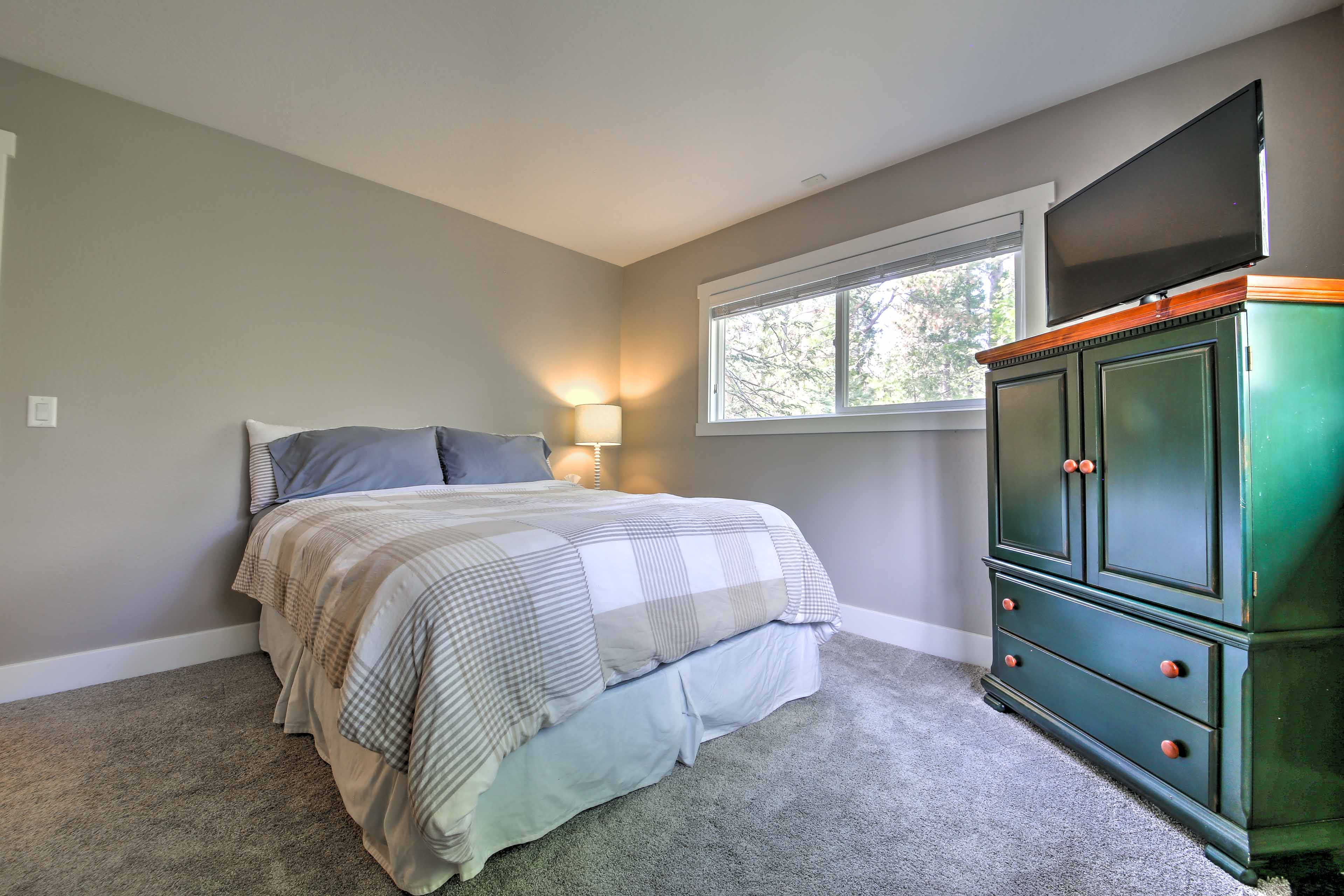 The third bedroom has a queen-sized bed.