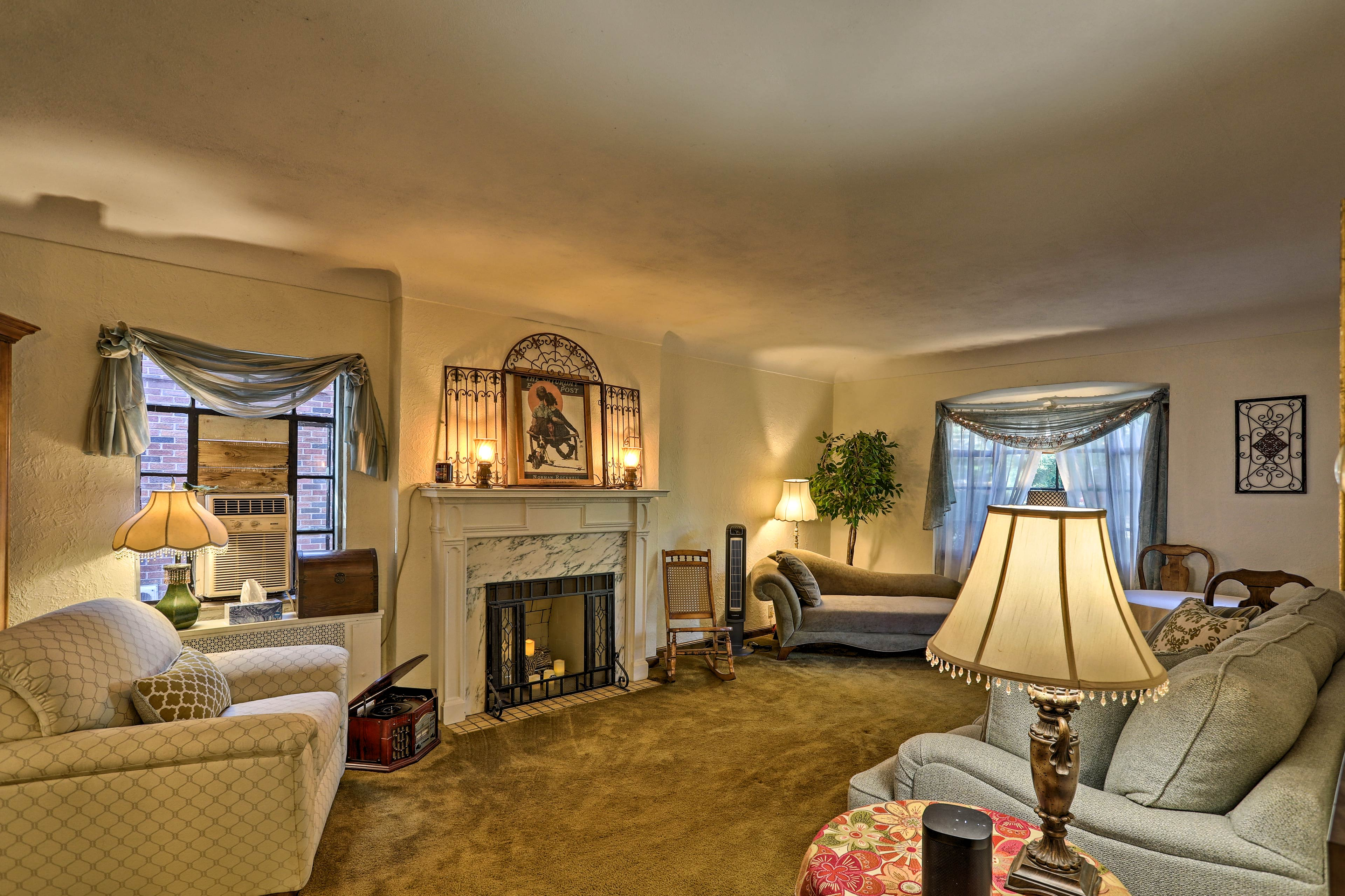 A faux fireplace with electric candles anchors the living room.