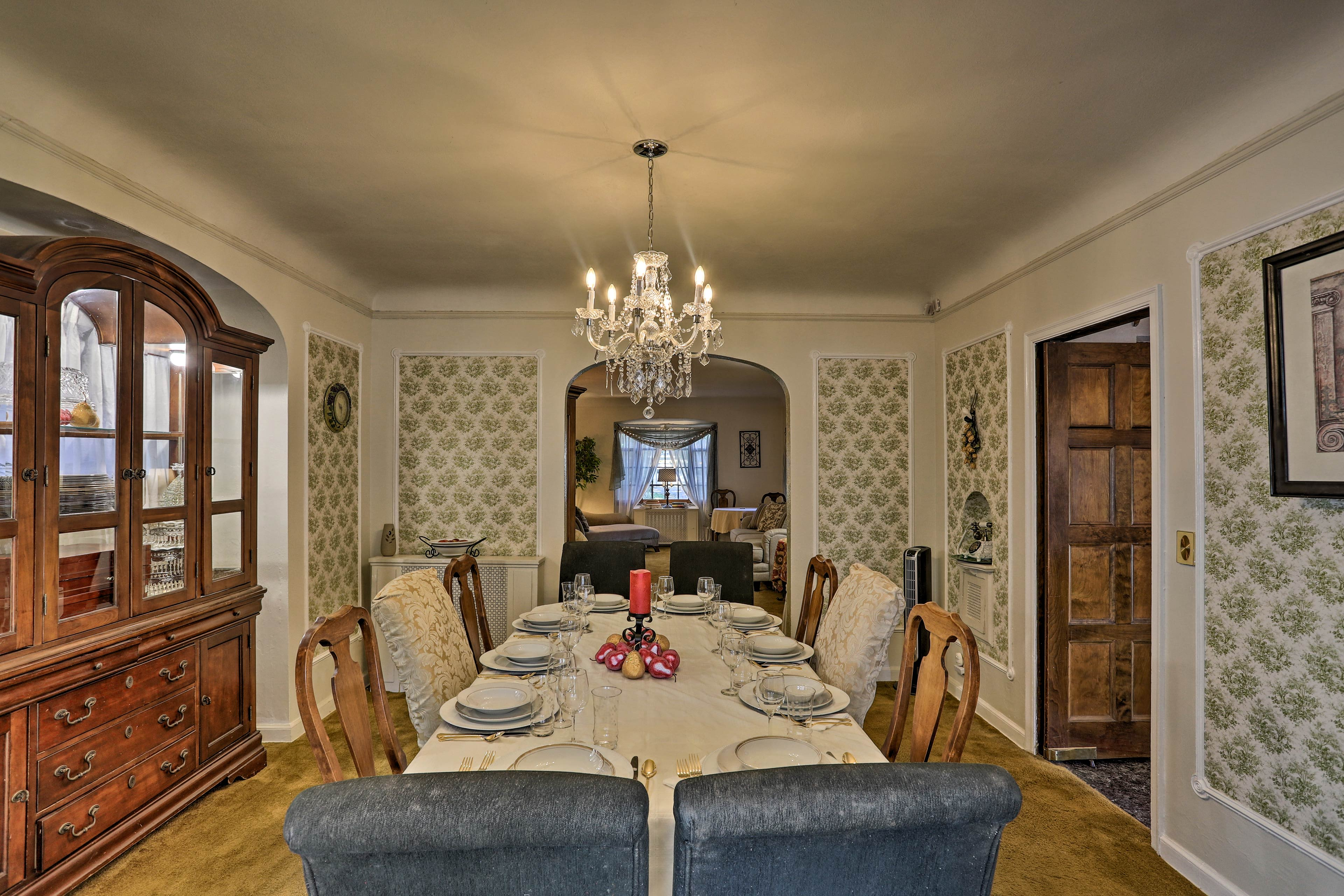 The fancy dining room table can accommodate 8-10 guests!
