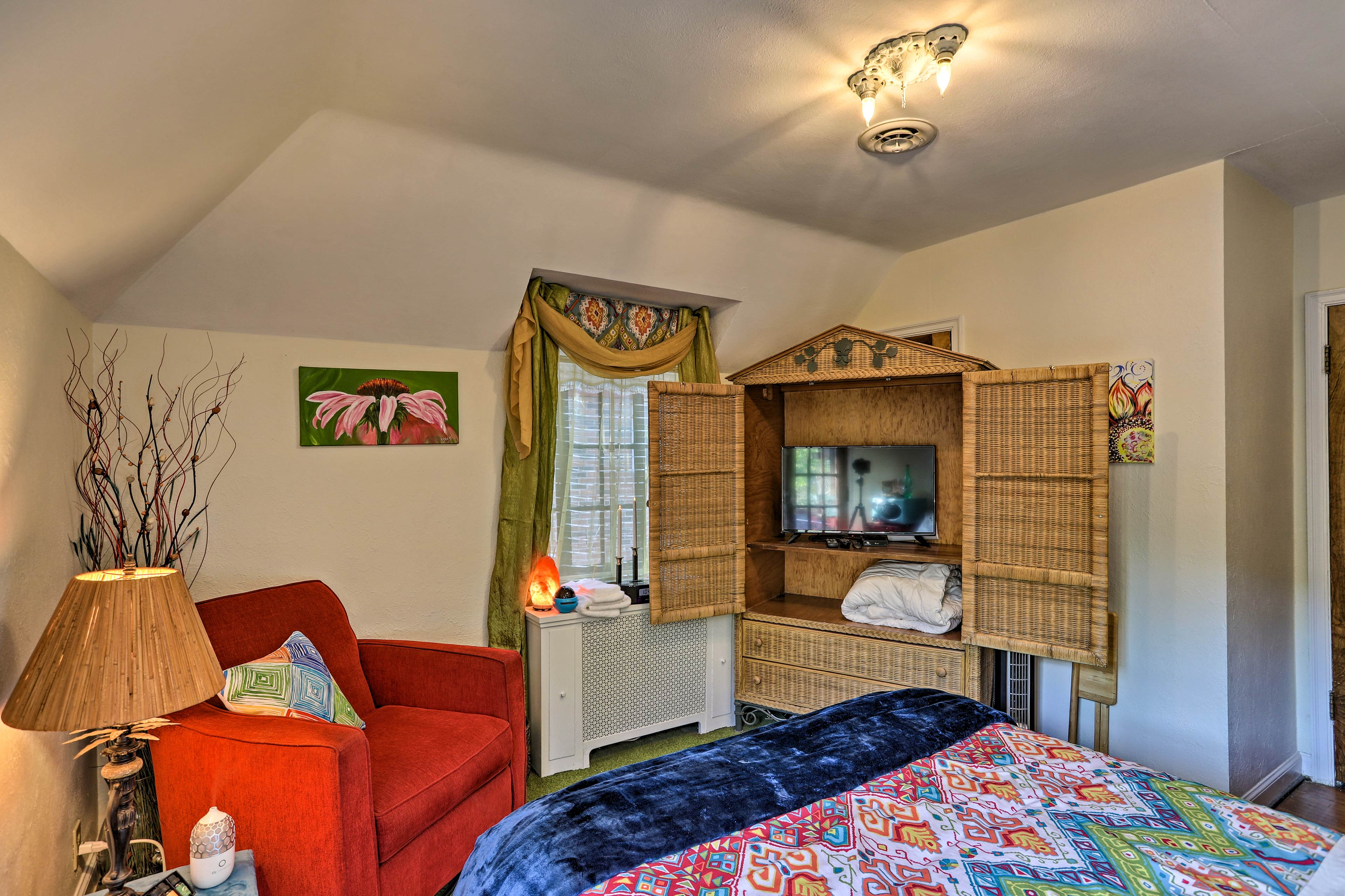 This room boasts another flat-screen Smart TV, plus a private balcony!