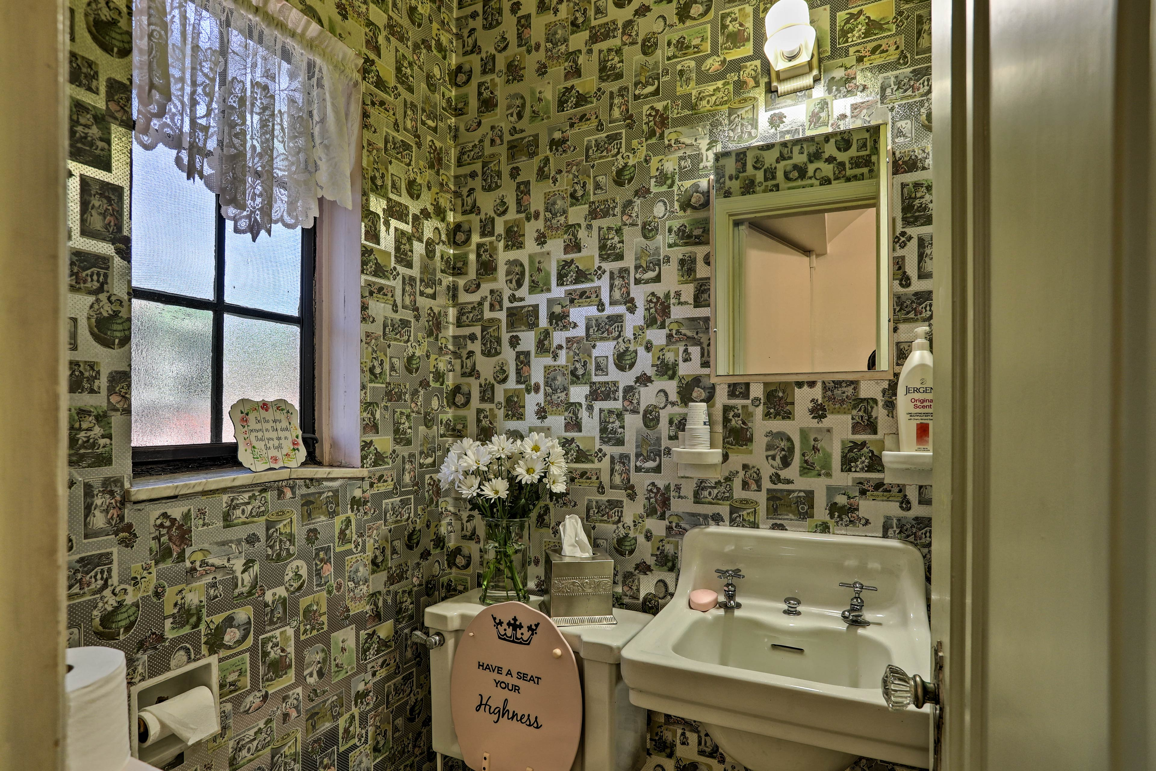 A half bathroom on the main floor adds convenience to your stay.