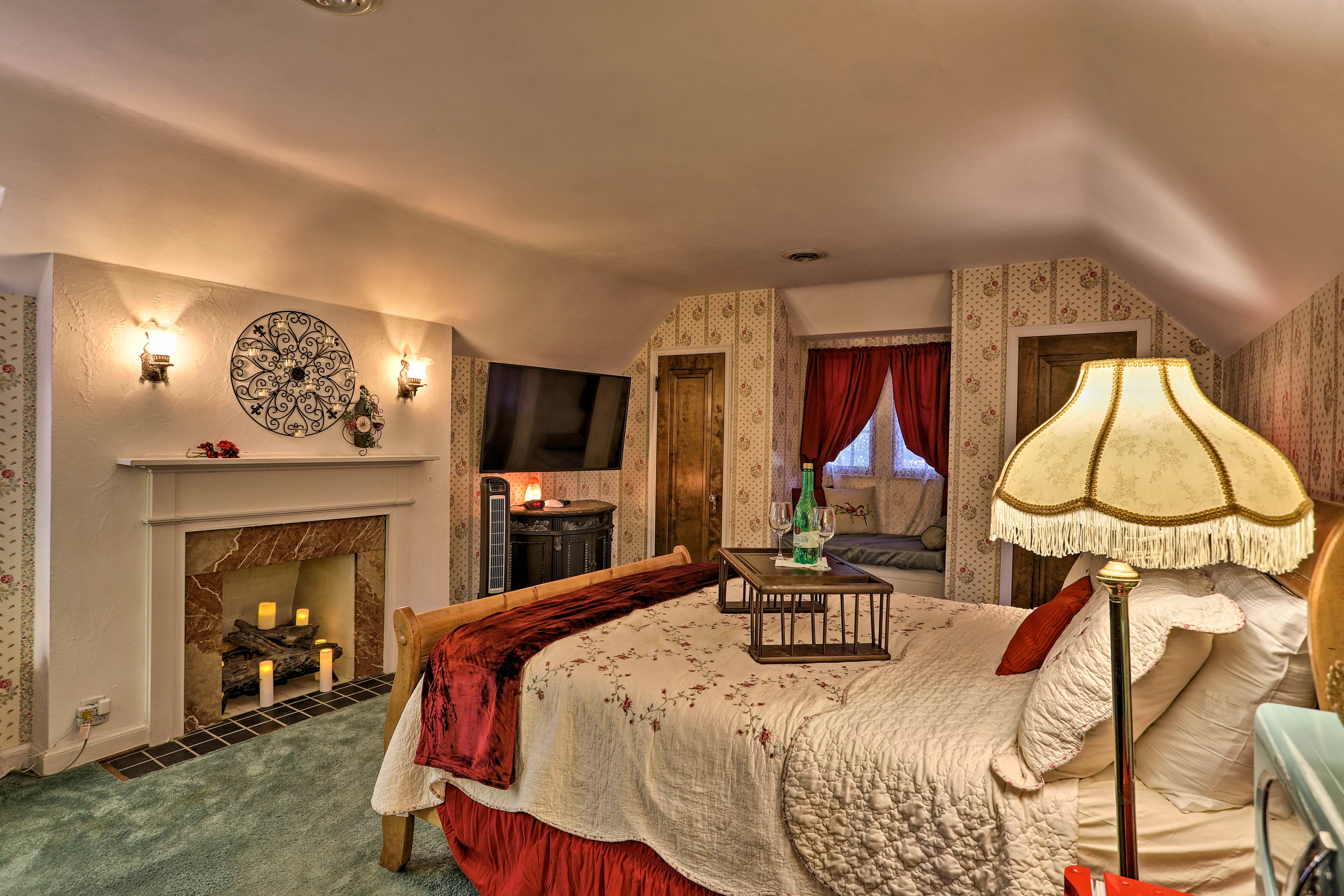 You'll love this room's faux fireplace, flat-screen Smart TV, & window nook!