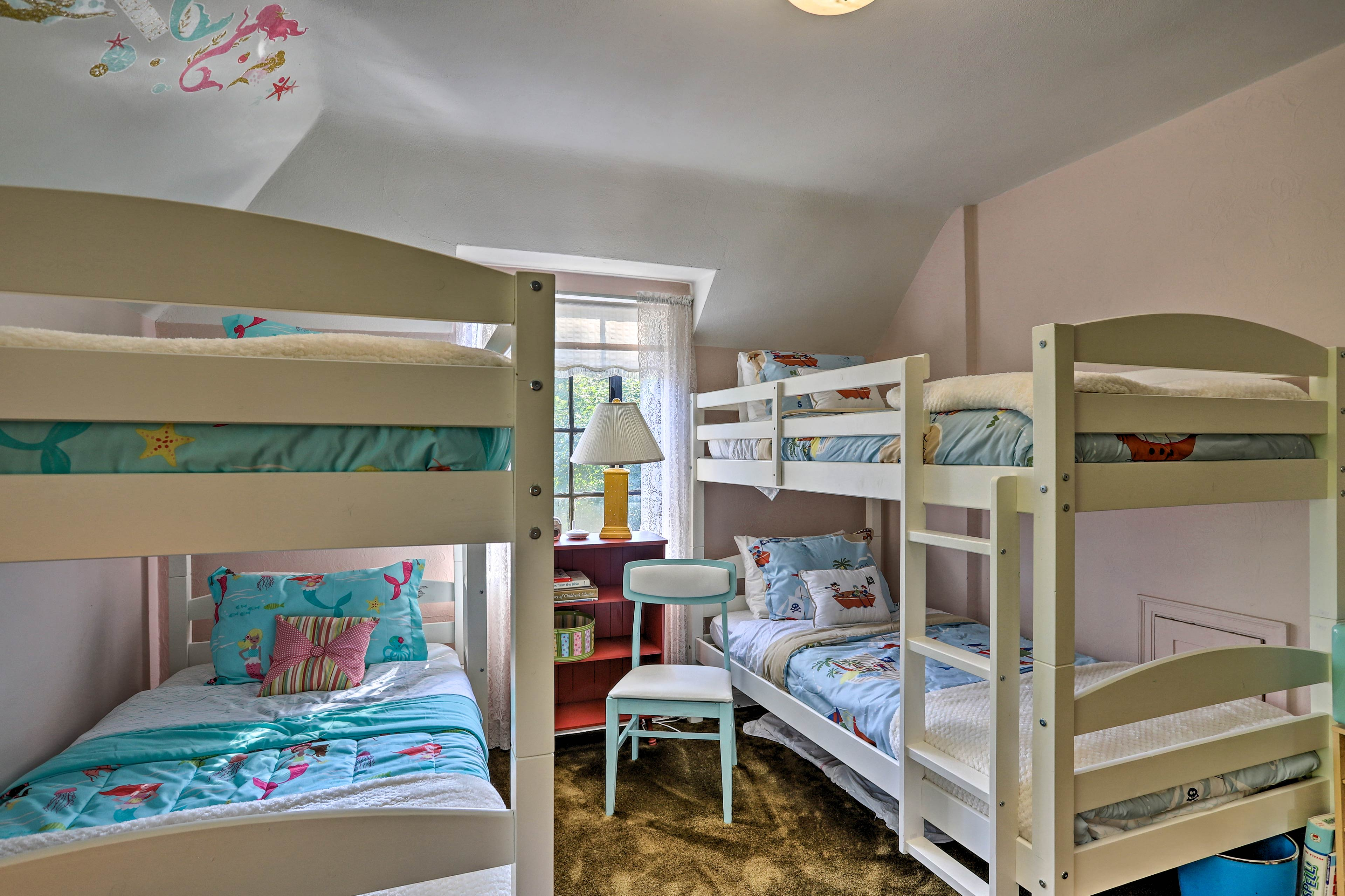 Tuck your kiddos into bed in the third bedroom.