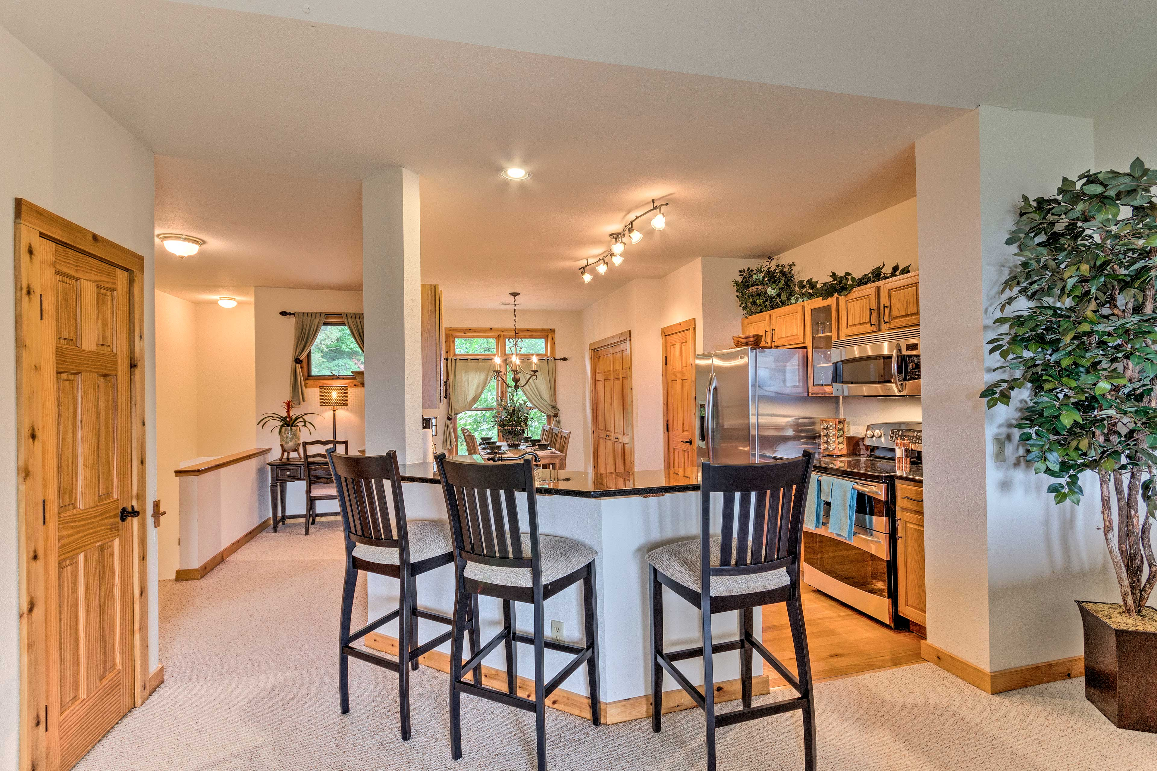 A high-top breakfast bar and stainless steel appliances complete this kitchen.