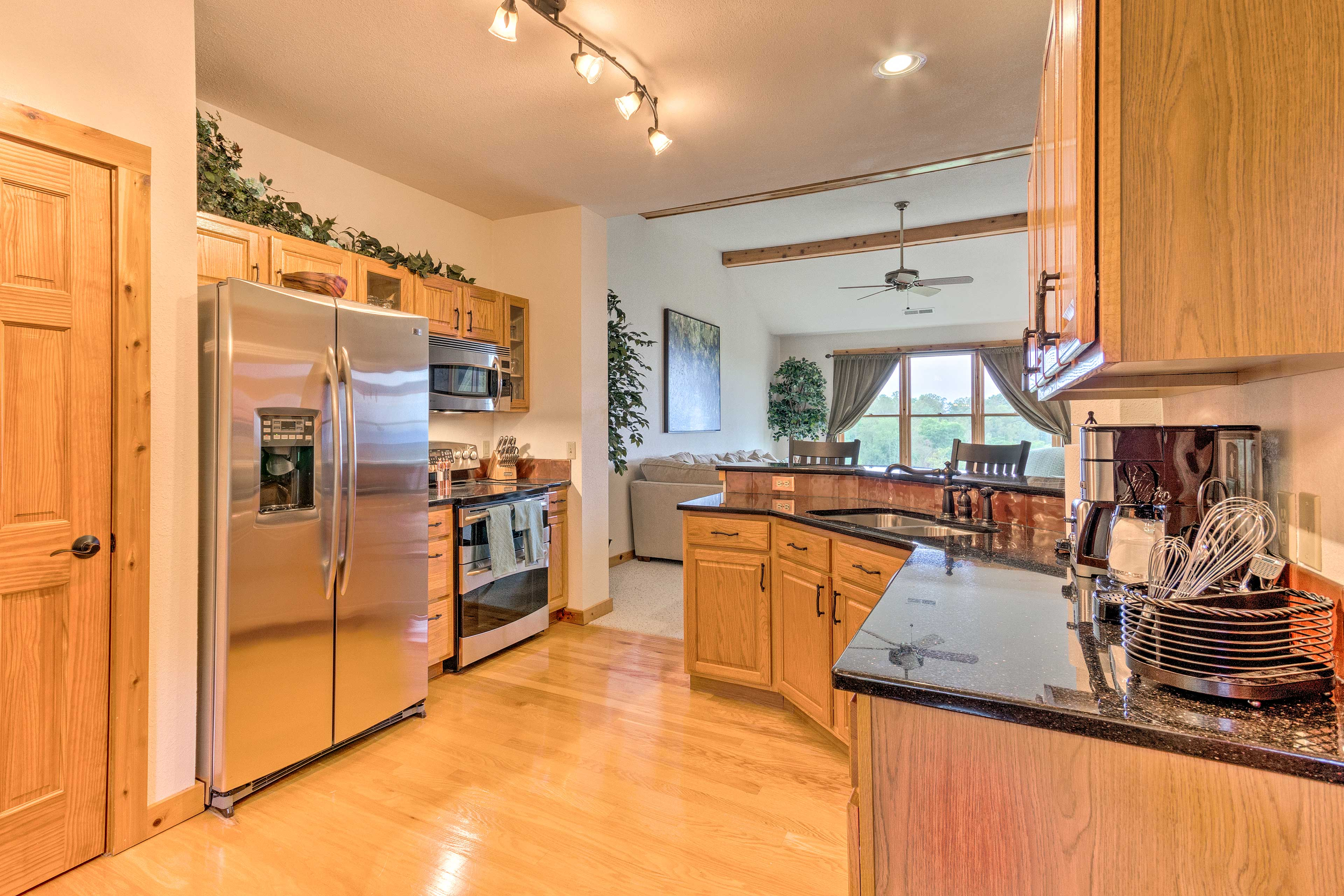 The kitchen is equipped with a full knife set, a spice rack, and coffee maker.