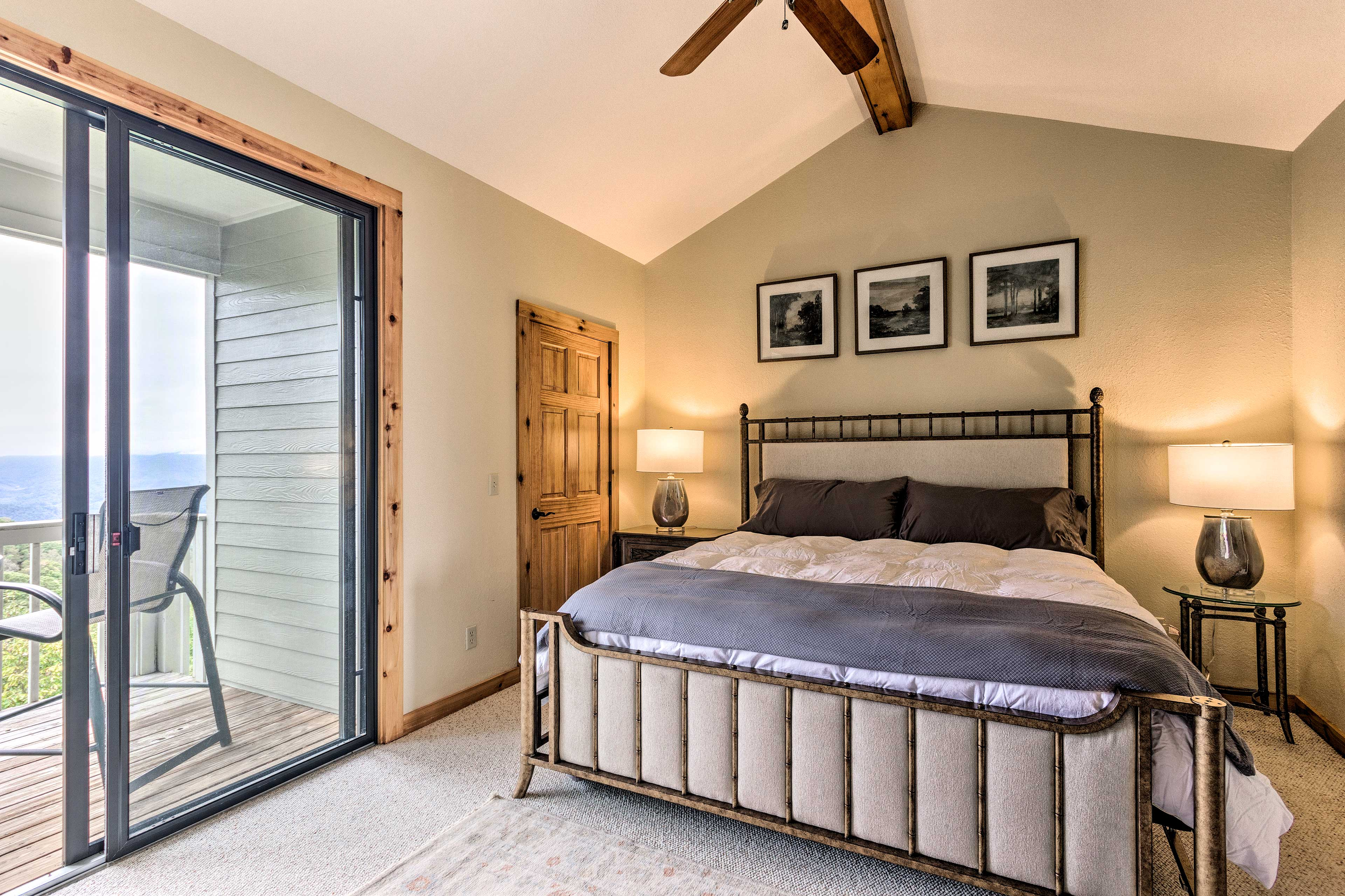 Claim the master suite's king-sized bed as your own.
