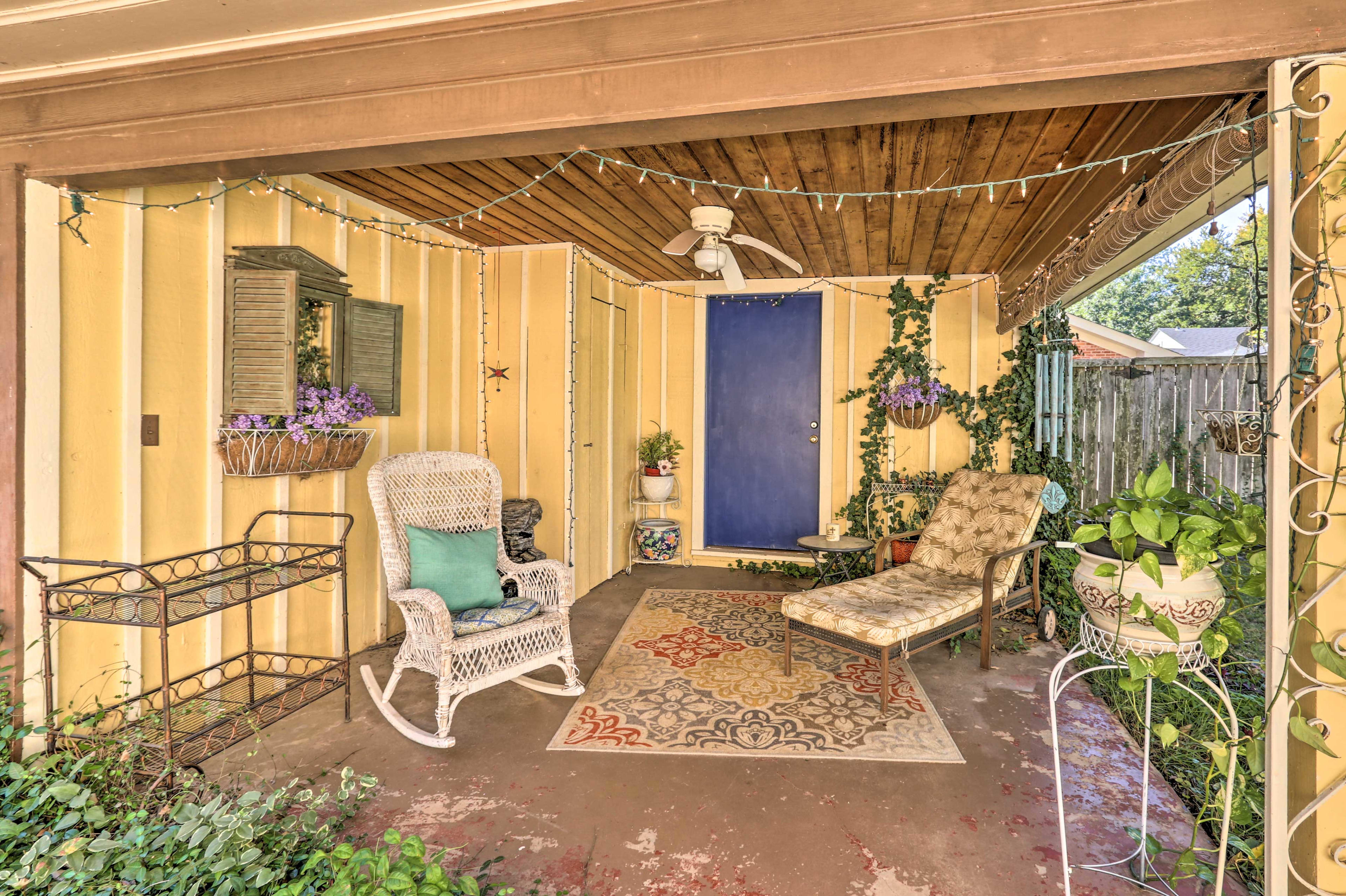Find solace beneath the patio's shelter and string lighting.