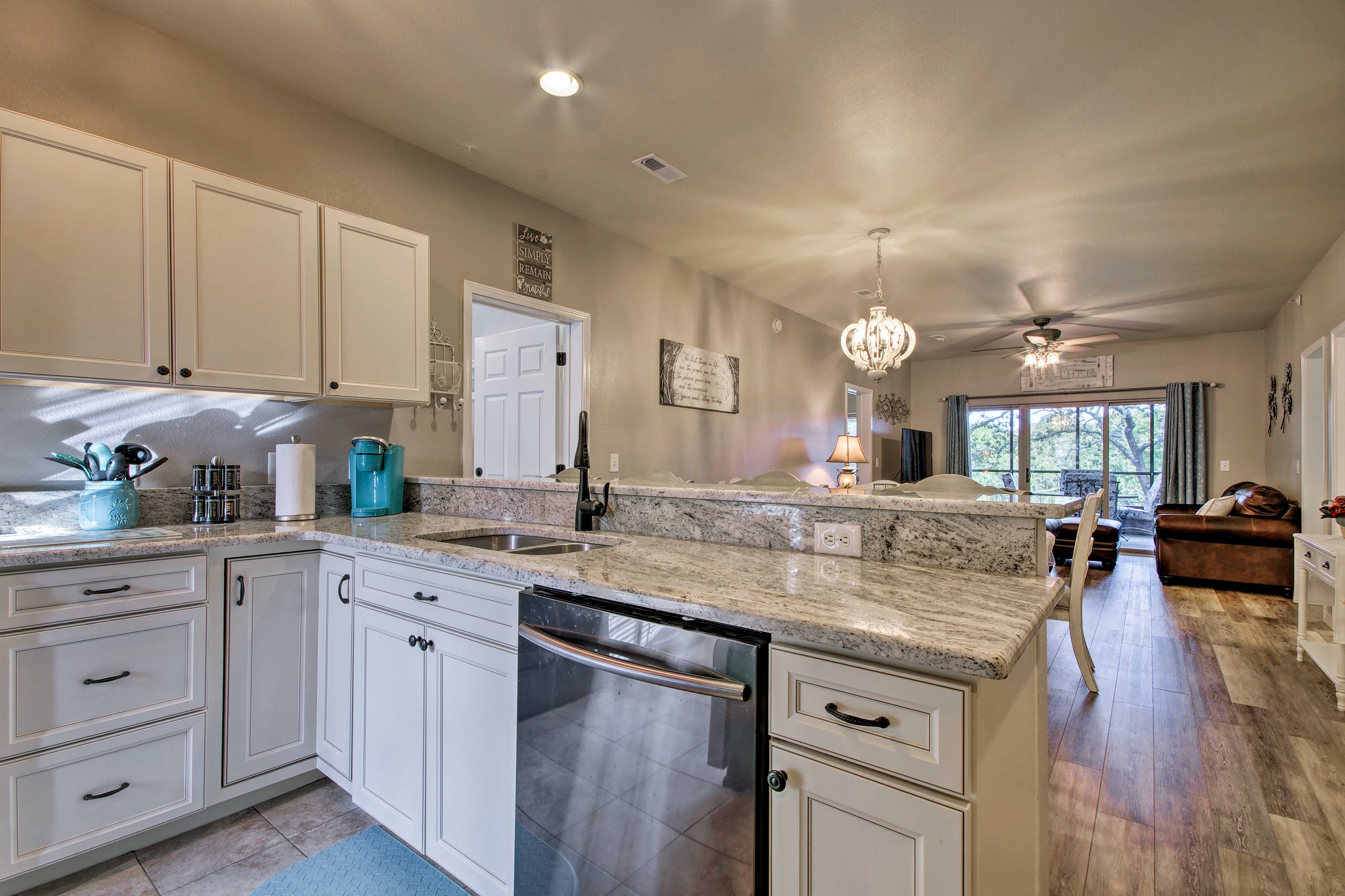 The modern kitchen features stainless steel appliances and granite counter tops.