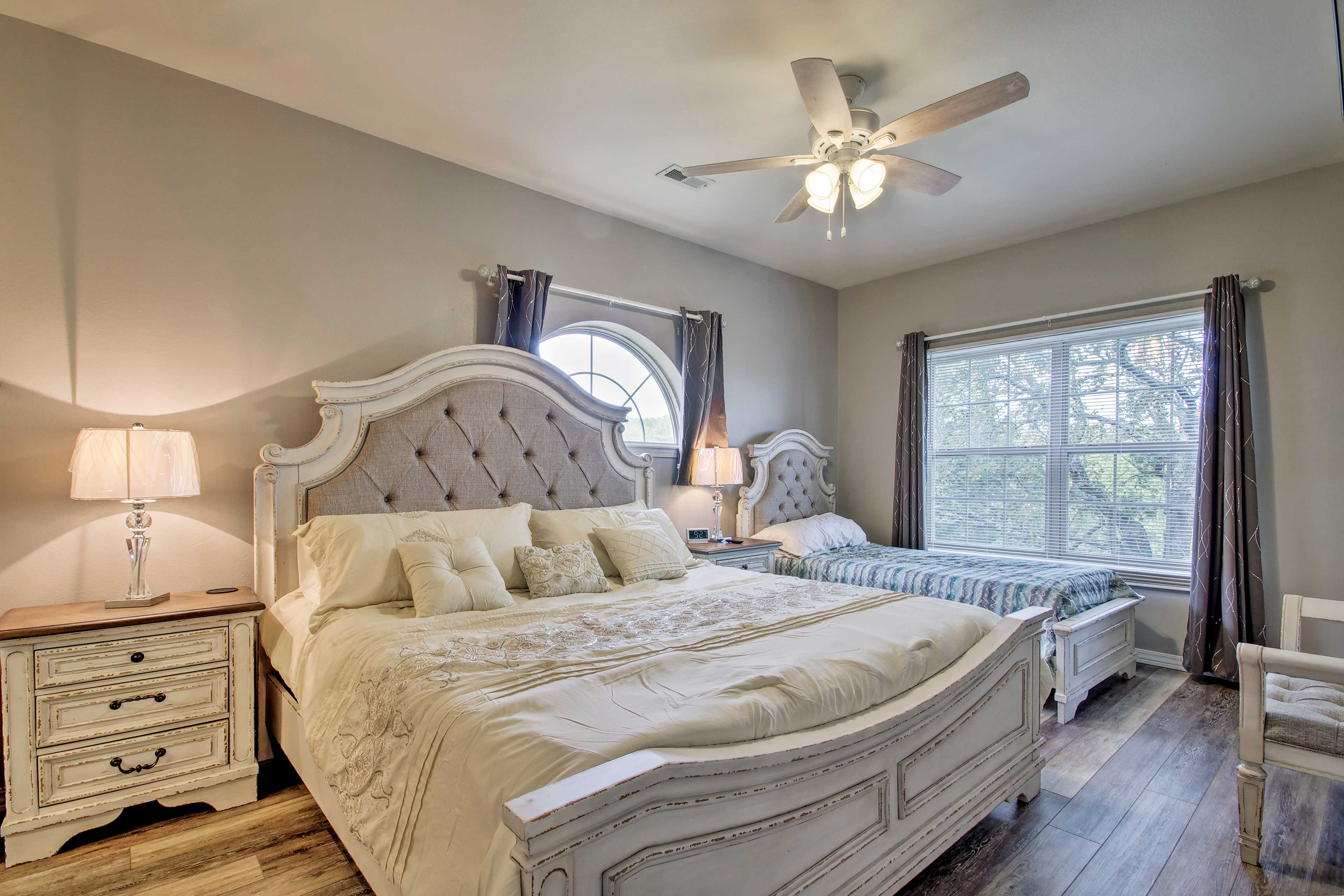 The third bedroom features a king-sized bed and a twin bed.