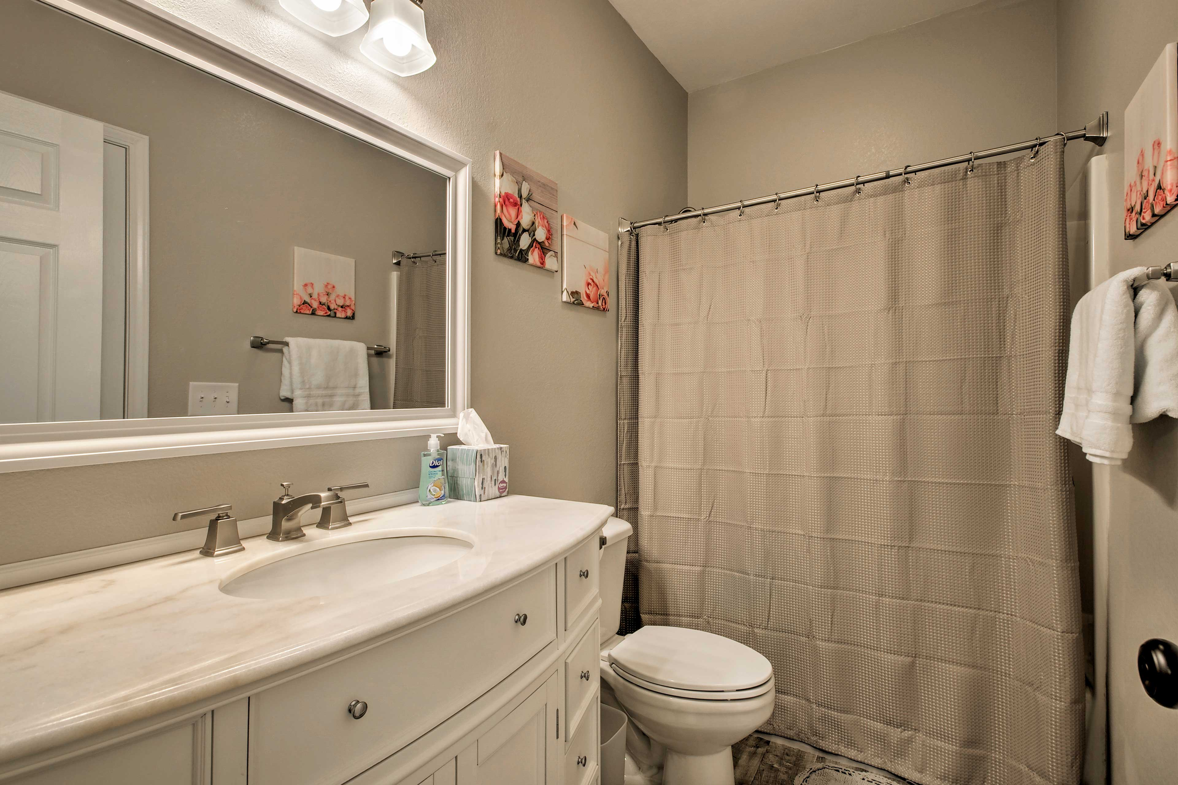 Get ready for the day in this bright bathroom.