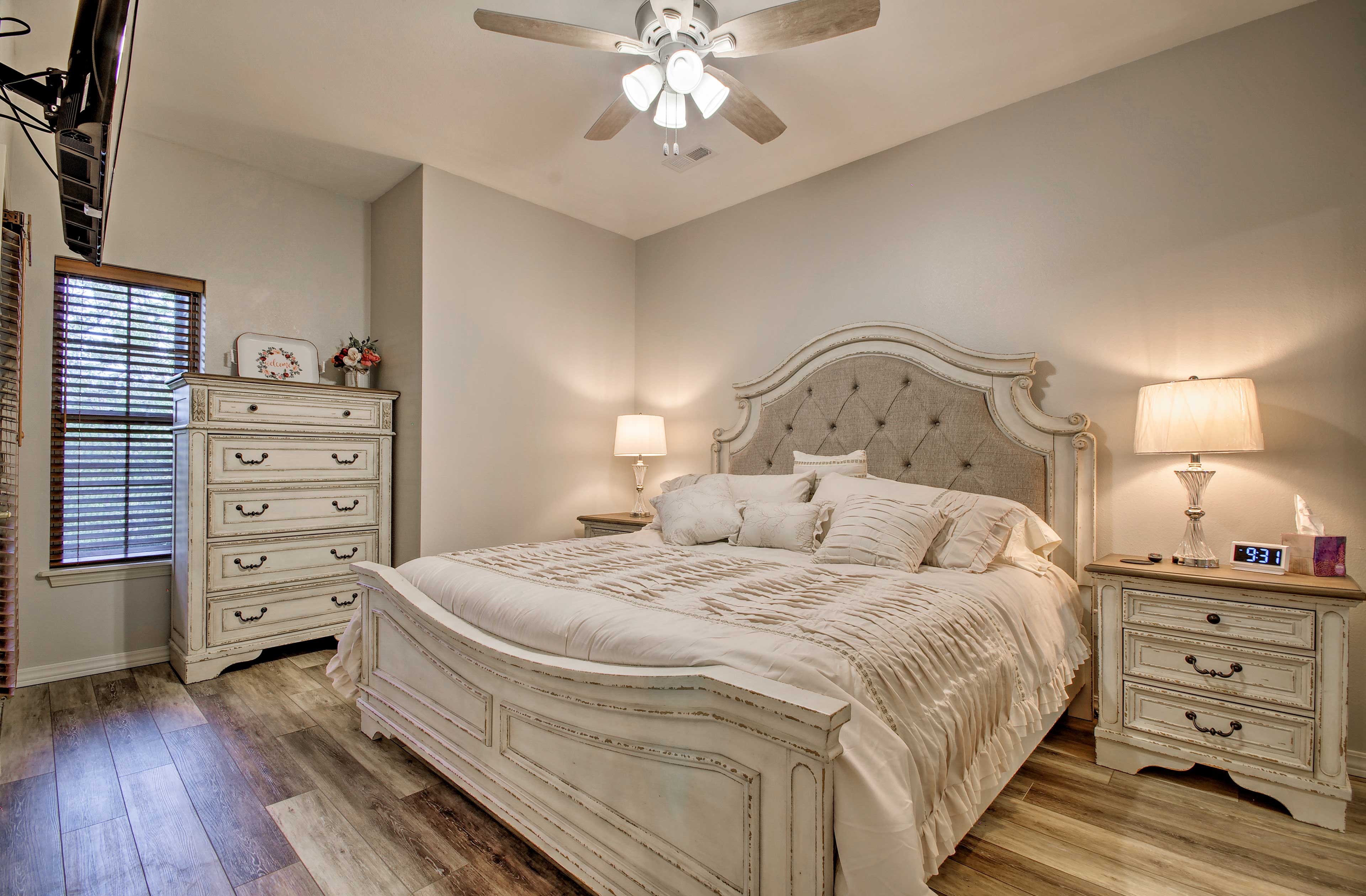 The master bedroom features a grand king-sized bed.