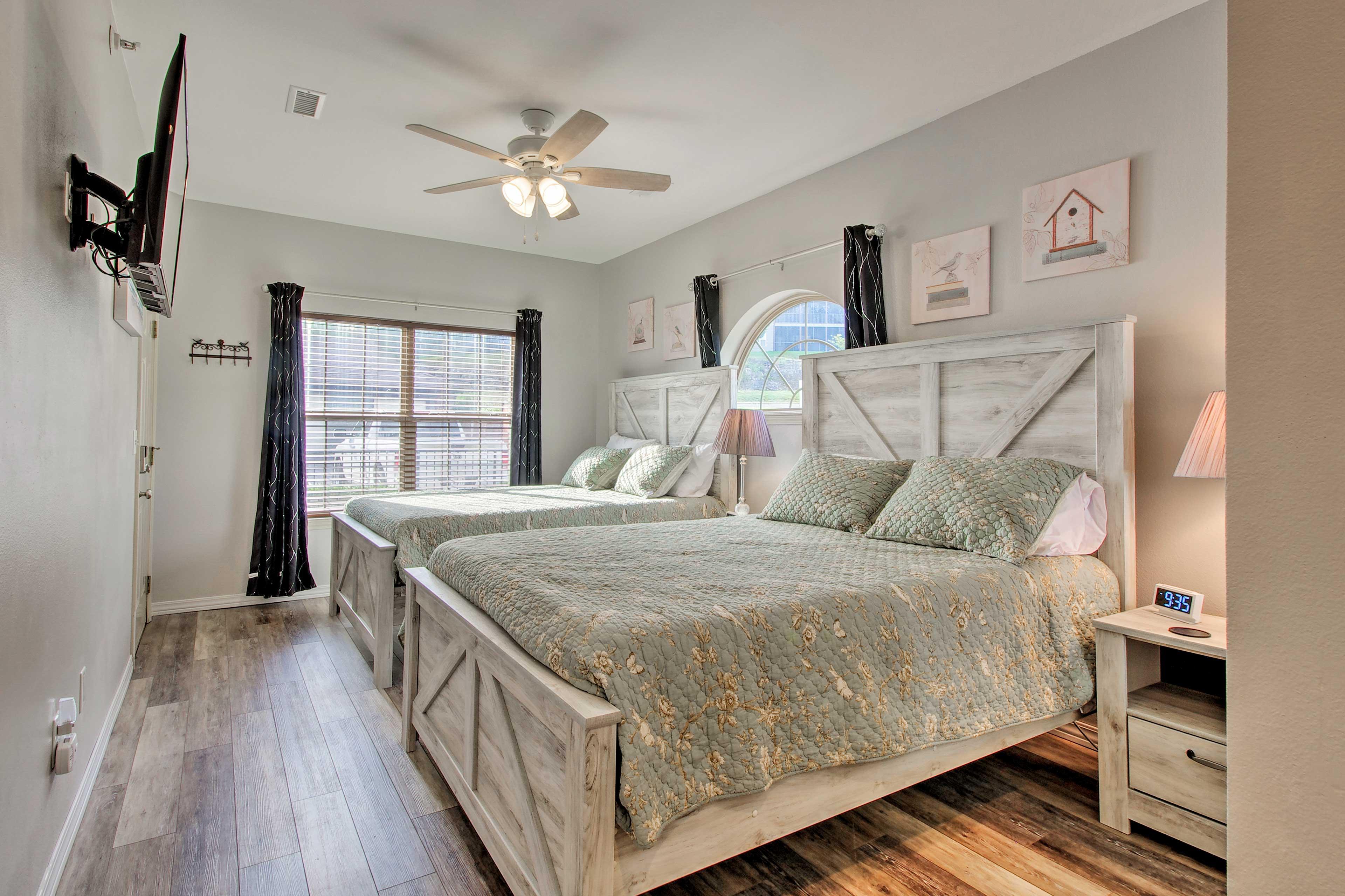 Sleep 4 in this bedroom's 2  queen-sized beds.