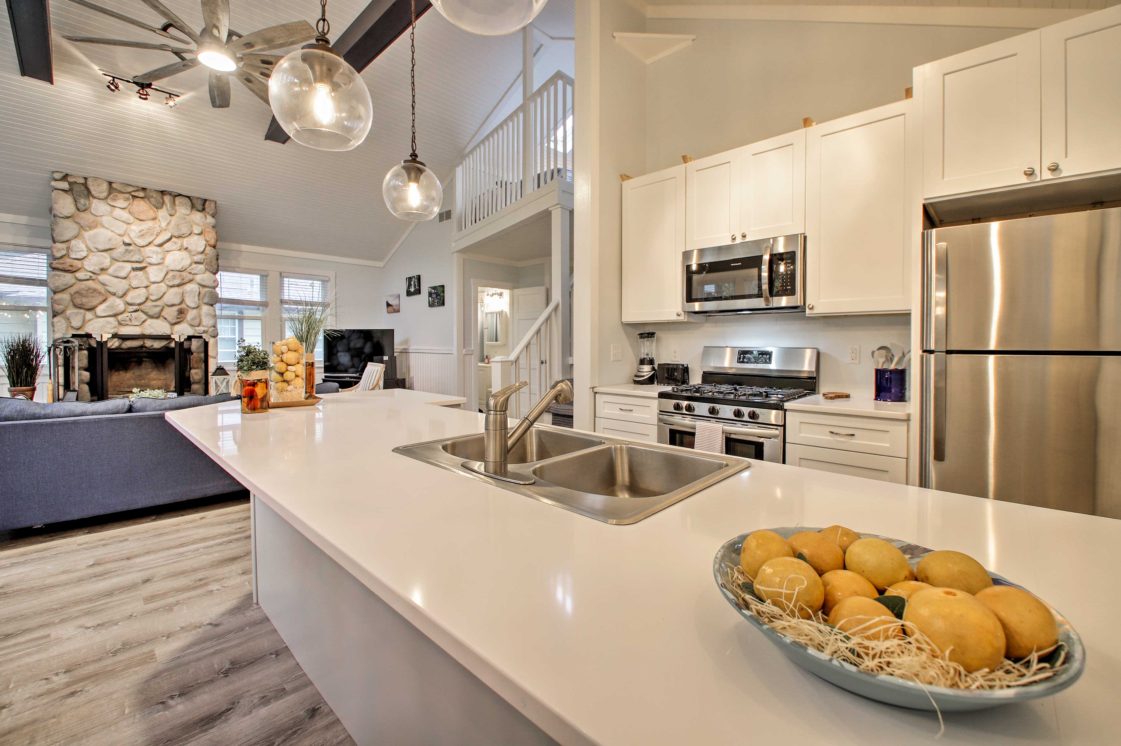 Stainless steel appliances and sleek counters highlight the kitchen.