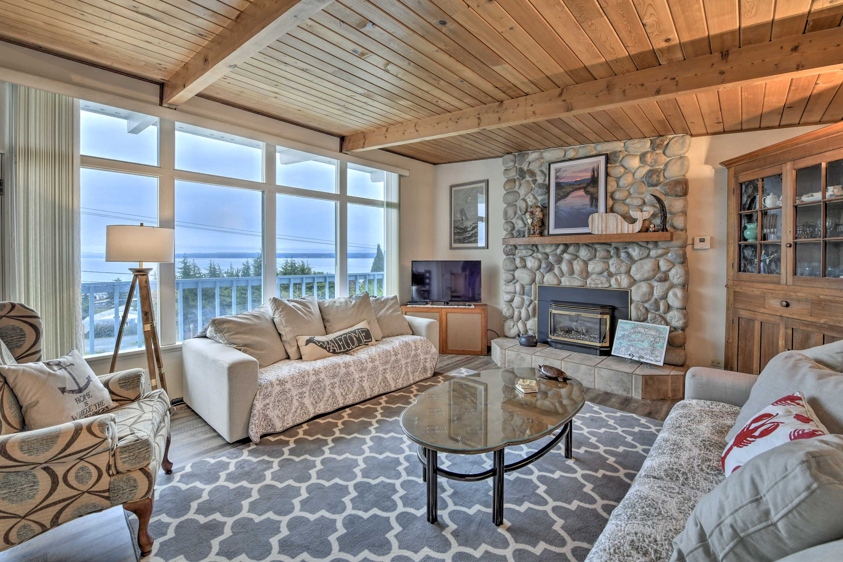 Curl up bu the fire during your stay at this 2-bedroom, 2-bath home!