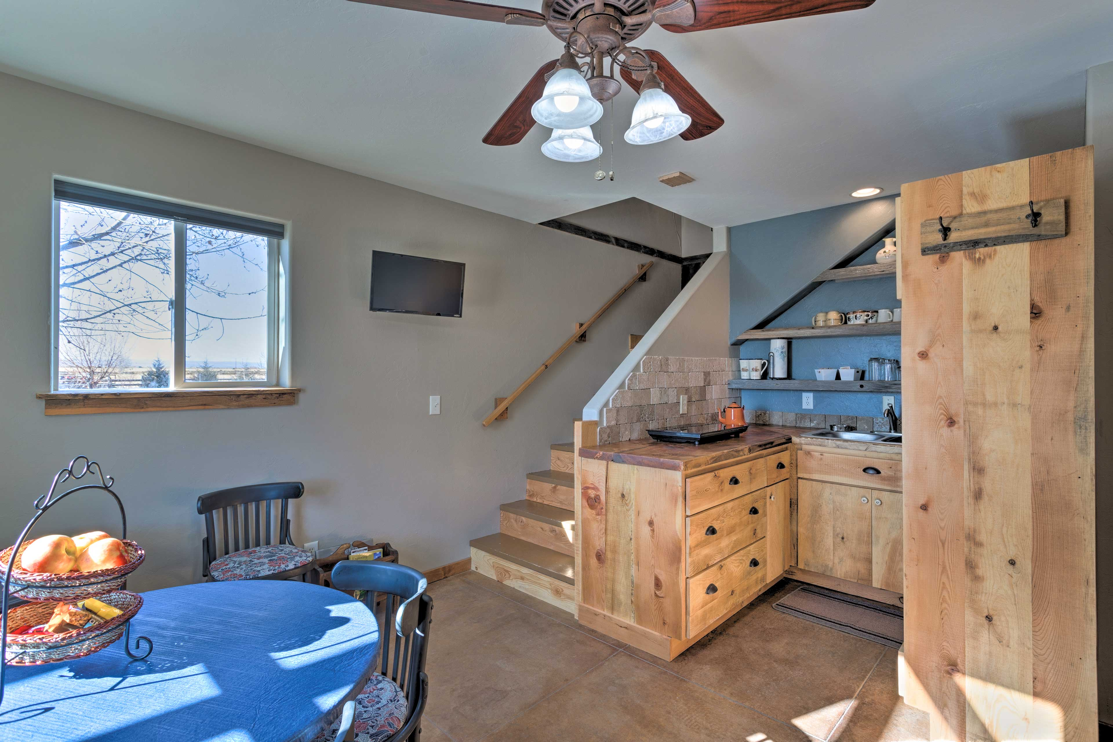 This vacation rental features a well-equipped kitchen.