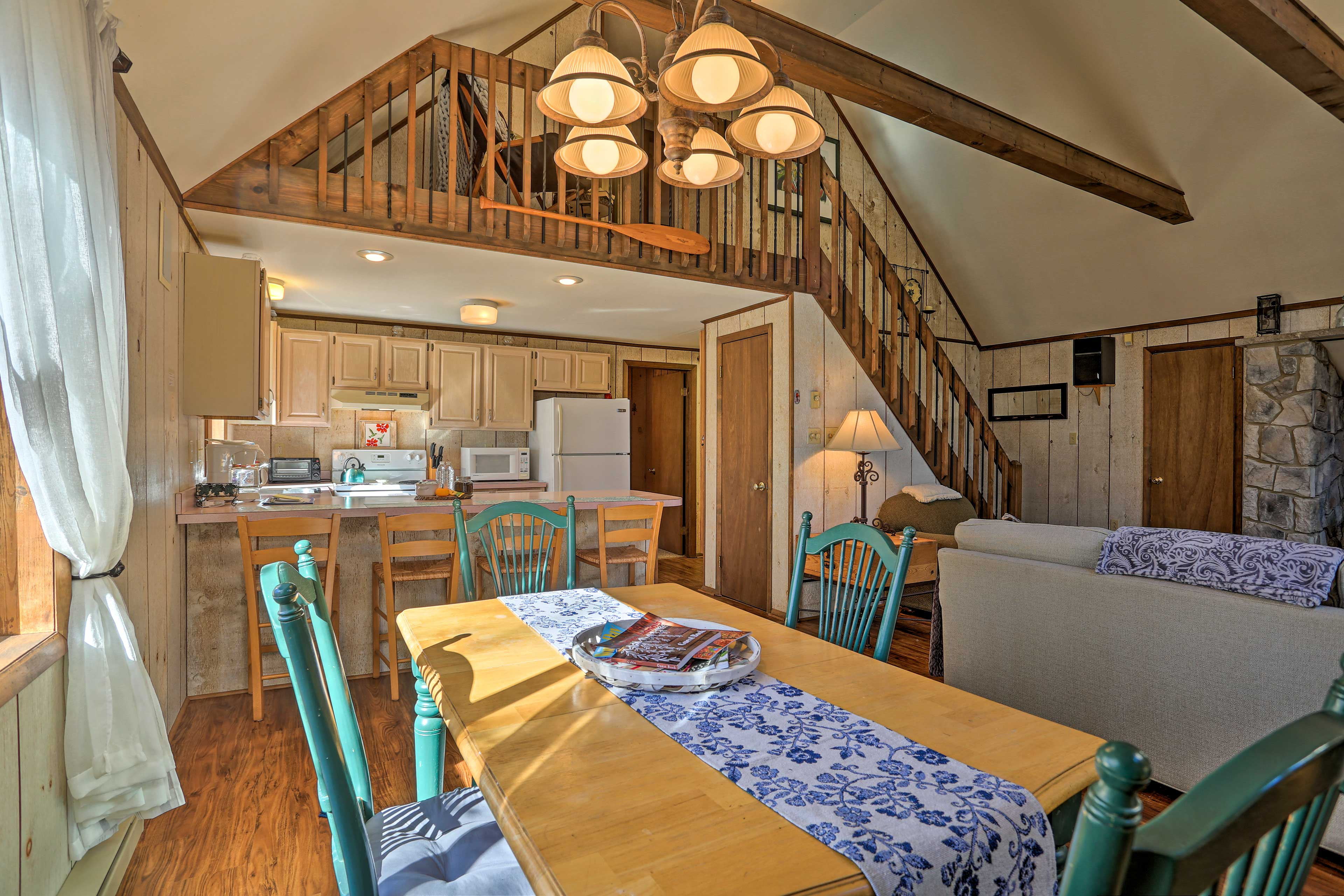 Hardwood flooring and vaulted ceilings complete the open living area.