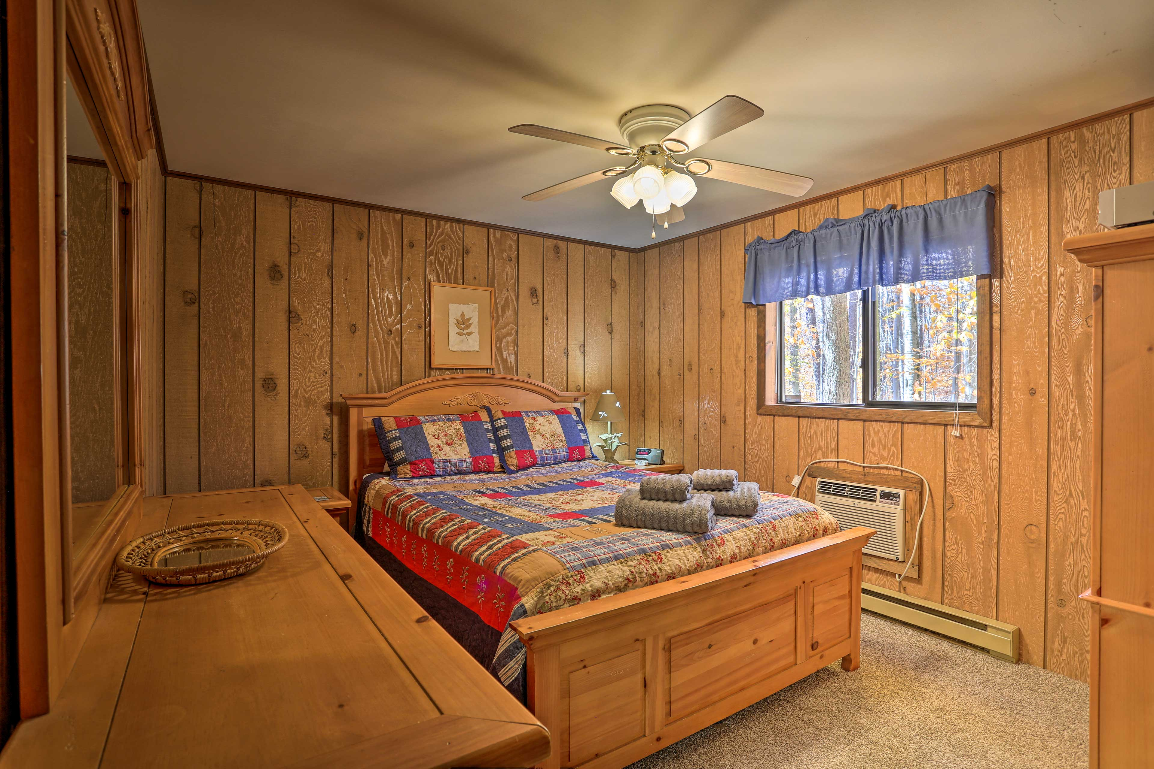 The master bedroom is complete with a queen bed and spacious dresser.