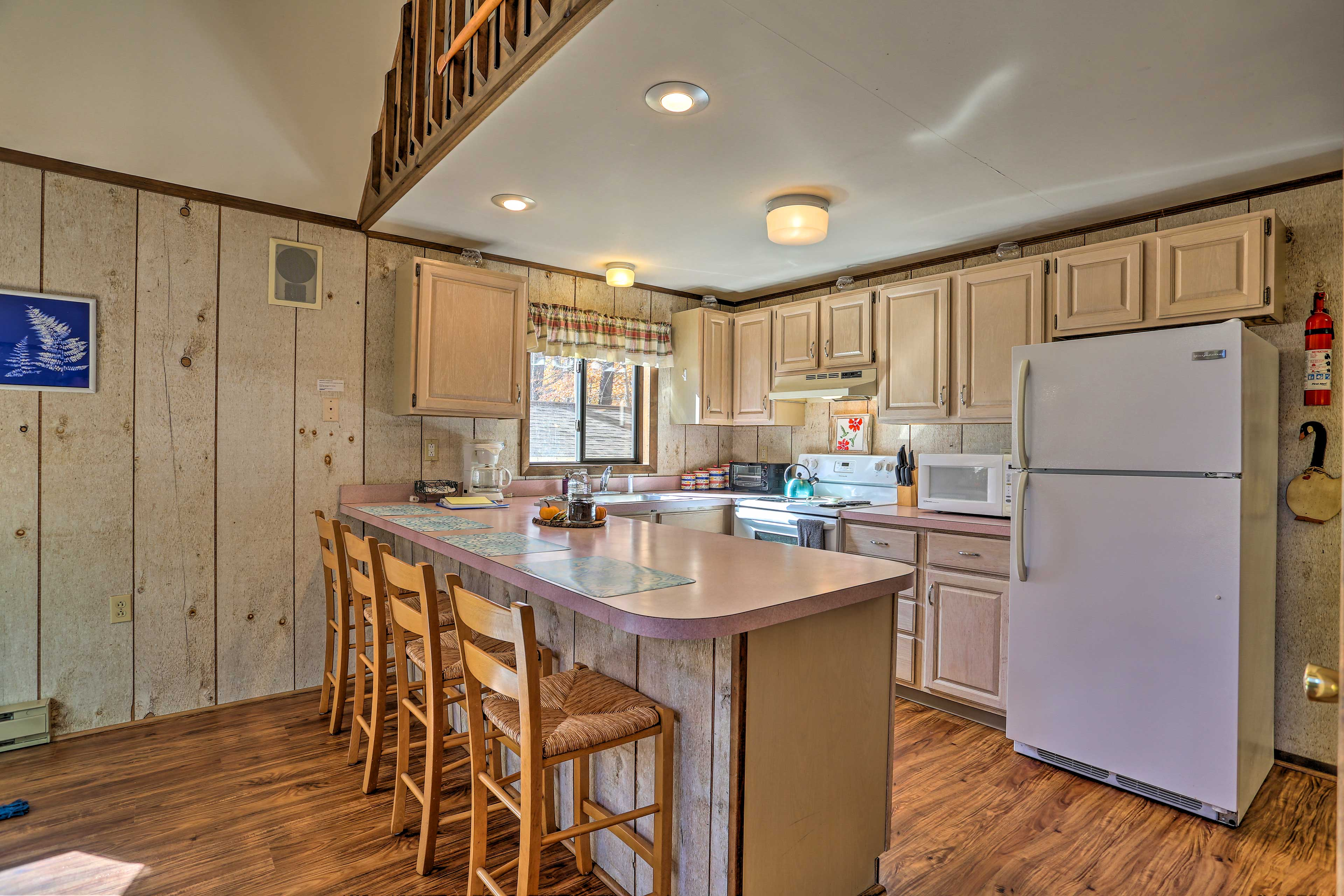 The living area leads into the fully equipped kitchen.