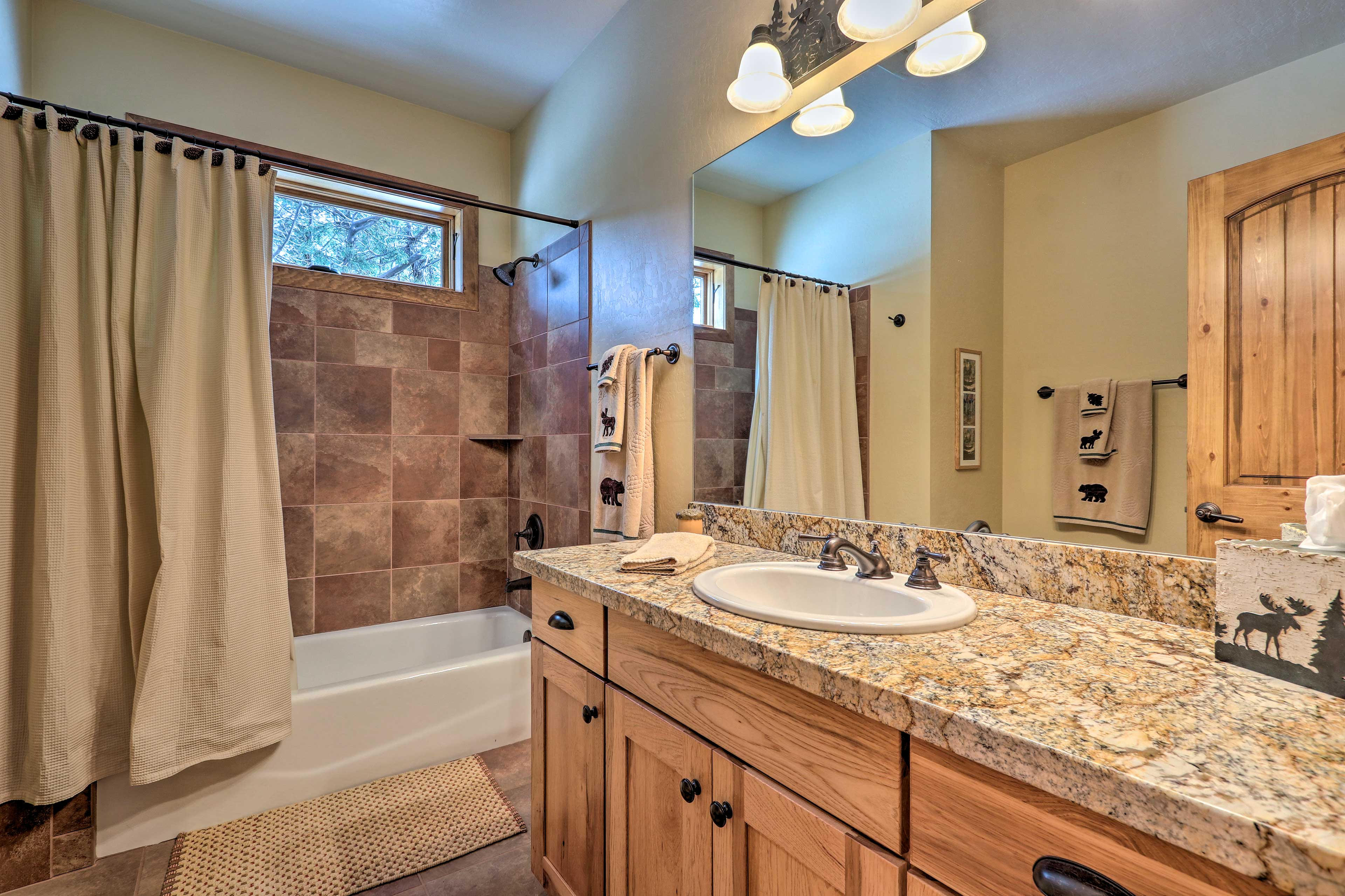 Granite counters add a pop of luxury to the full bathrooms.