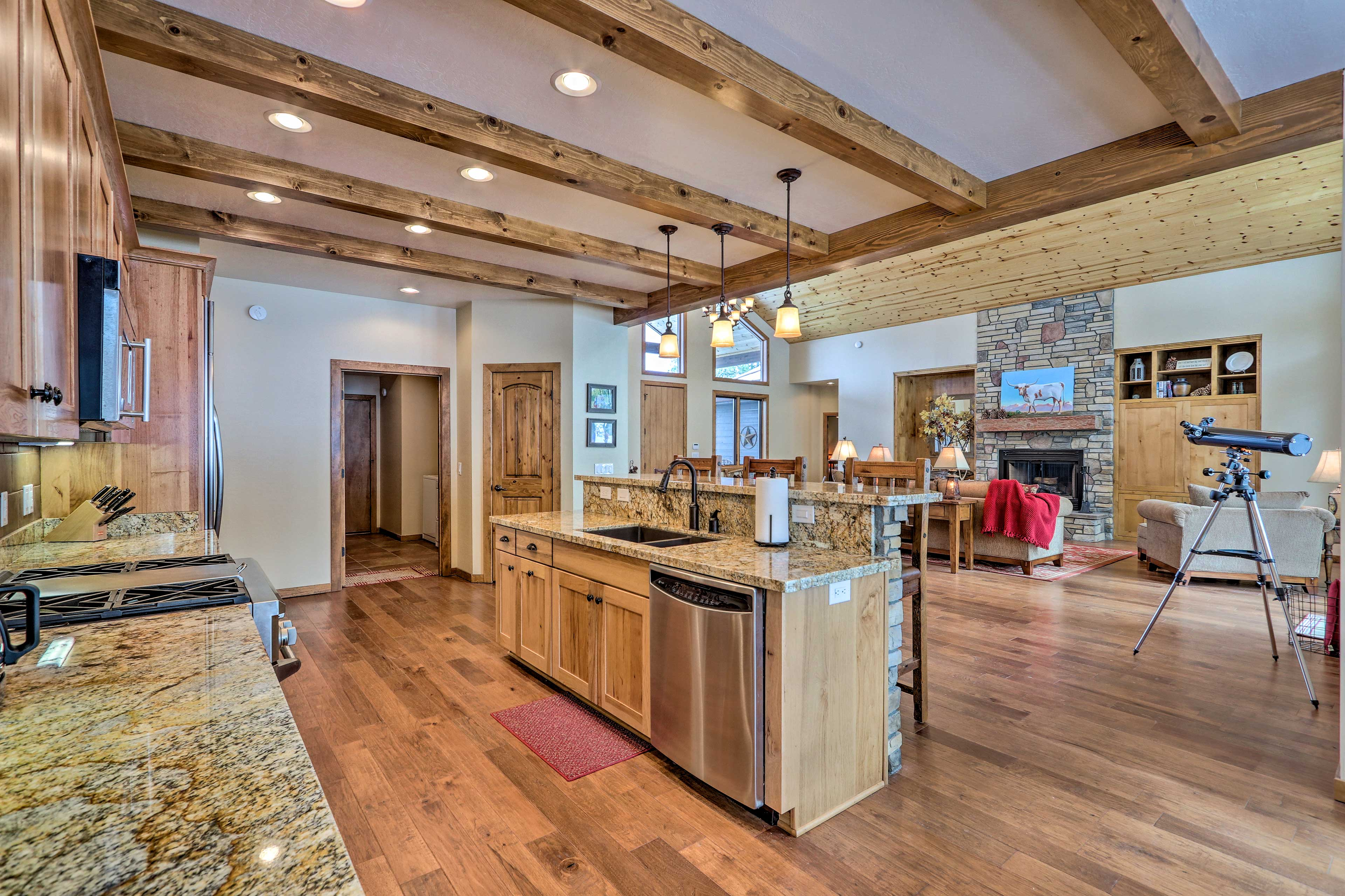 The kitchen opens up to the grand living room.