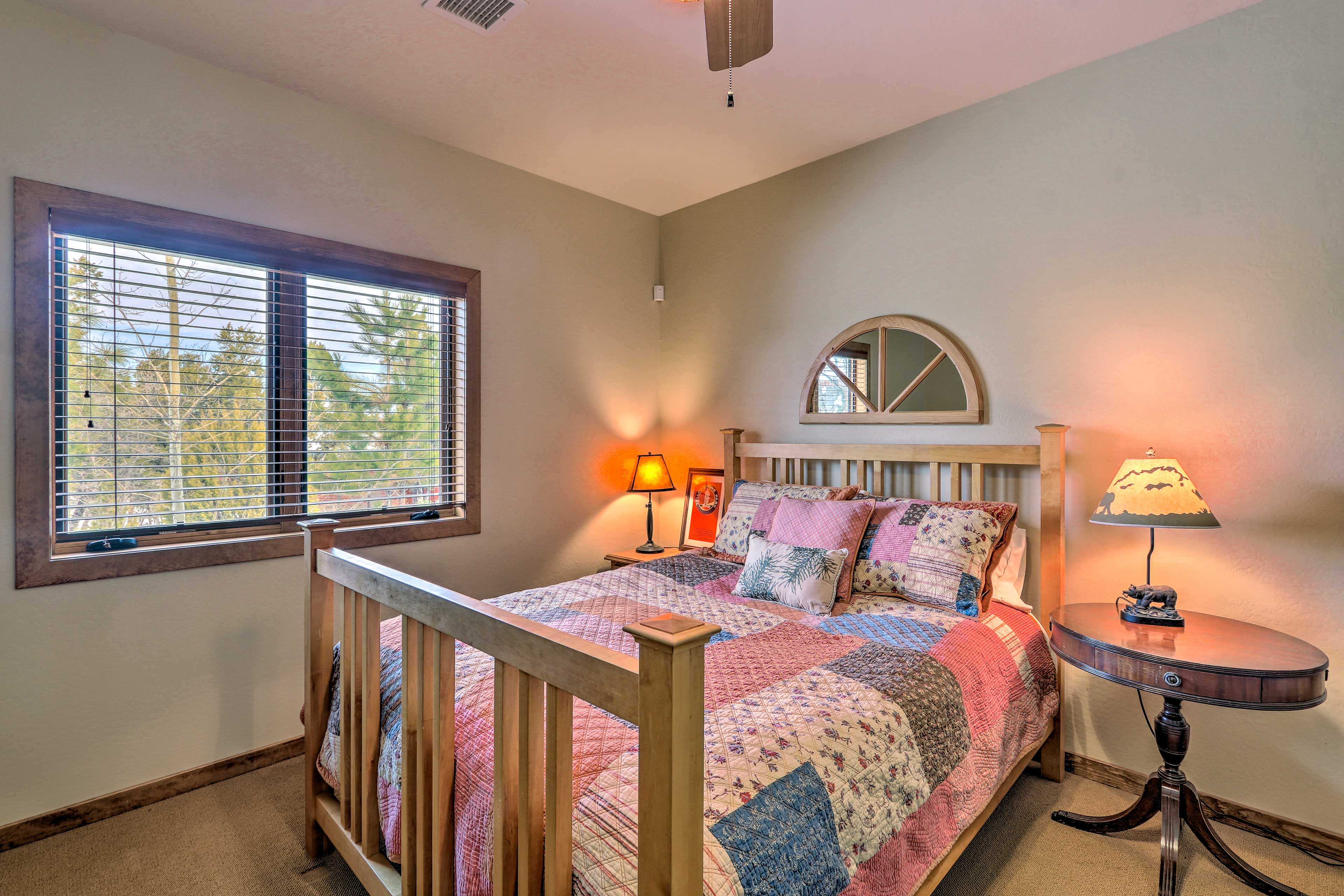 Two of the guest bedrooms feature queen beds.
