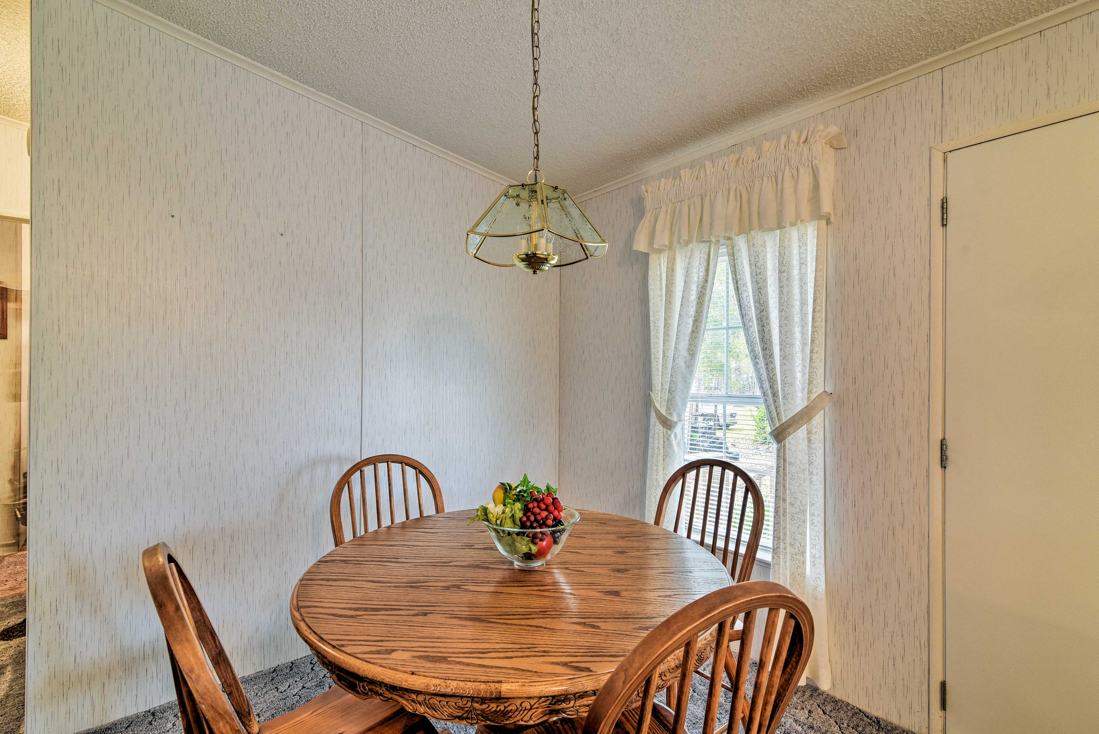Sit down and enjoy the company of family around this breakfast table.